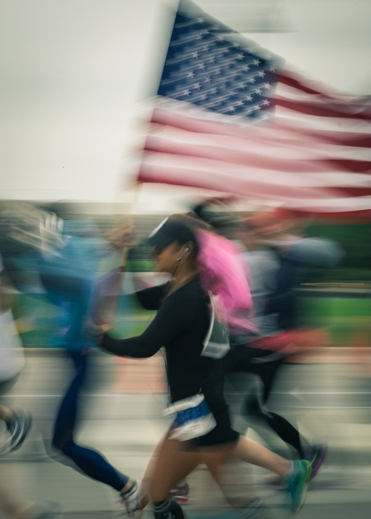 girl running with American flag.jpg