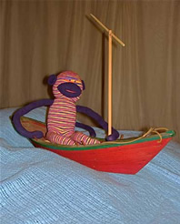 His best pal Auggie is too busy sailing...