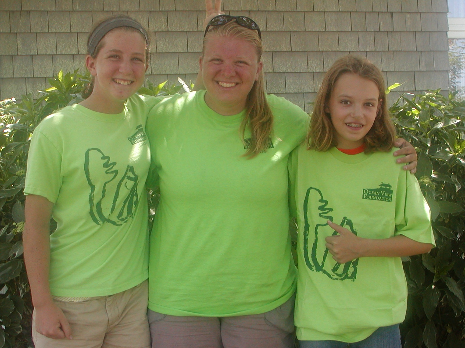 Summer Field Workers: Going left to right, Erica, Meg and Lucy posing outside of the library.