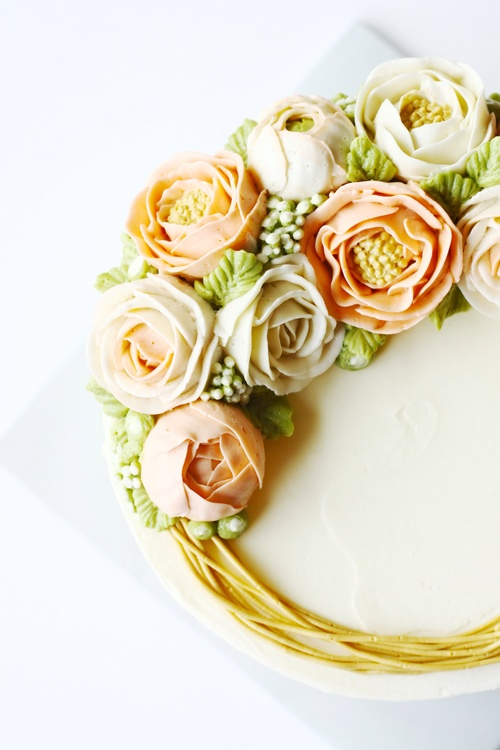Buttercream rose and peony flower cake