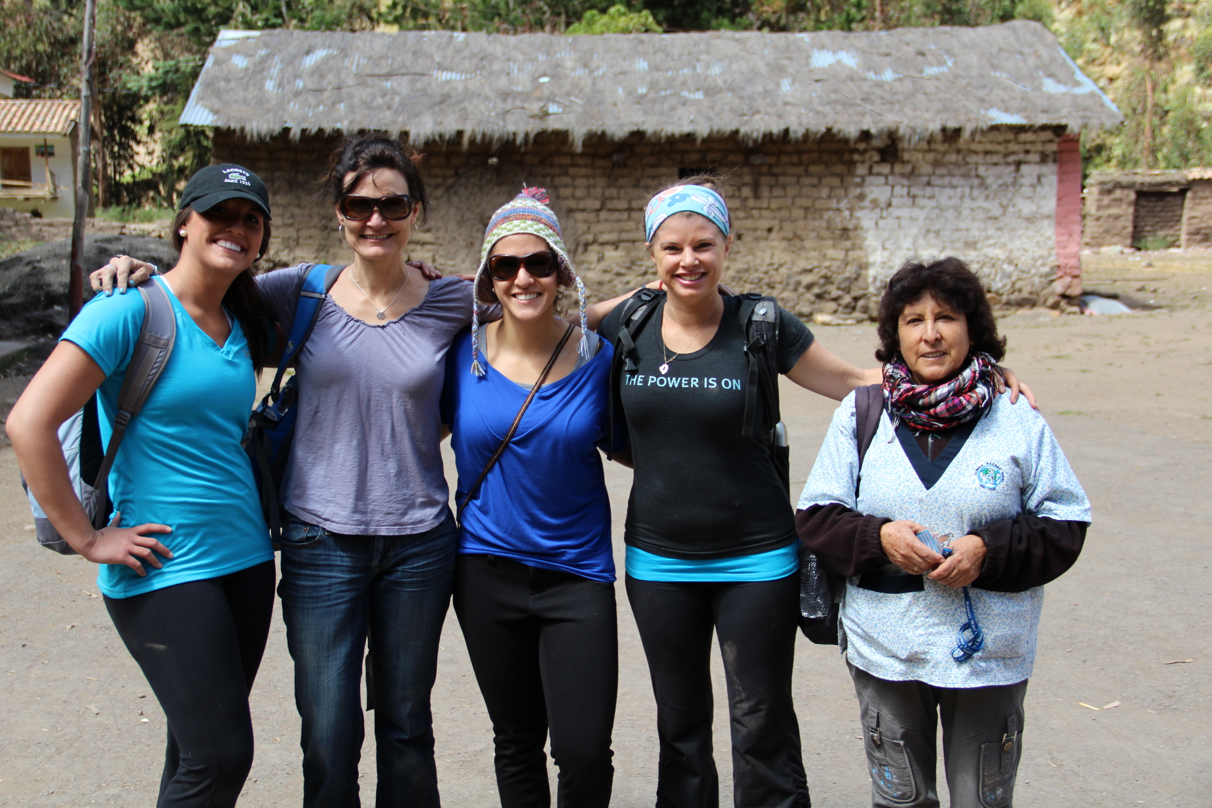 Jeni standing second from the left while on location serving children at a school in Peru, one of the rare photos she is actually in from that trip in 2013!