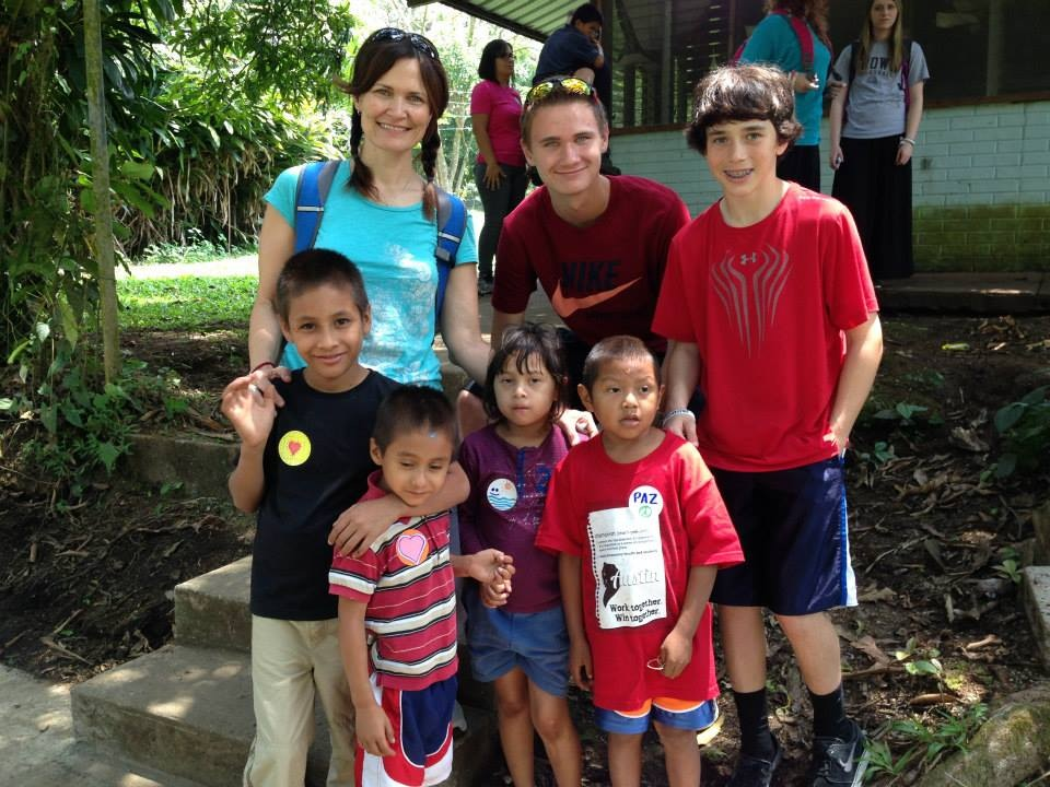 Jeni with her son Max connecting with children in Honduras