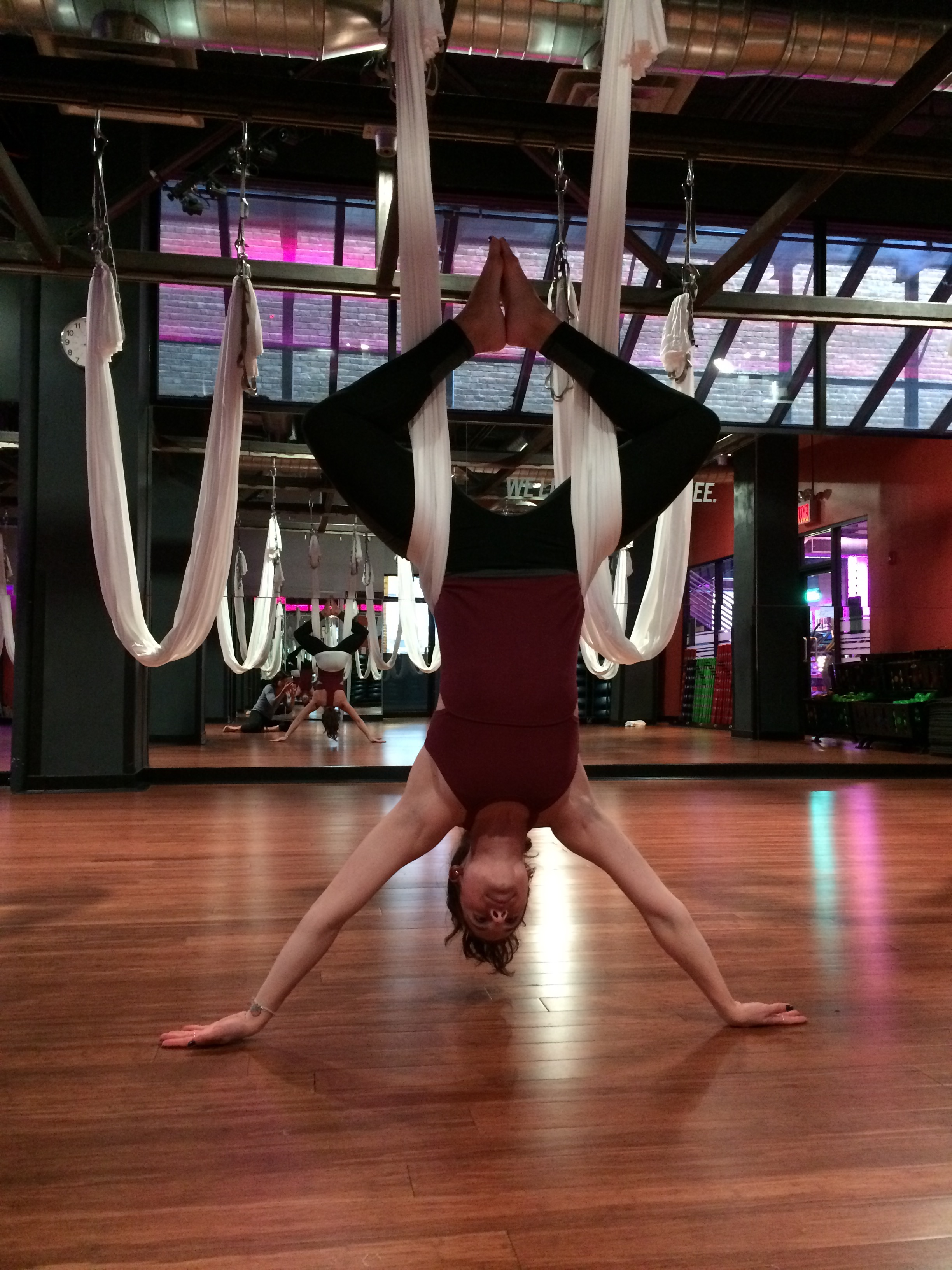 Here I am upside down after antigravity yoga class at Crunch gym with the same Free People Movement top.  I love the detailing of the top that you can see in the back mirror.