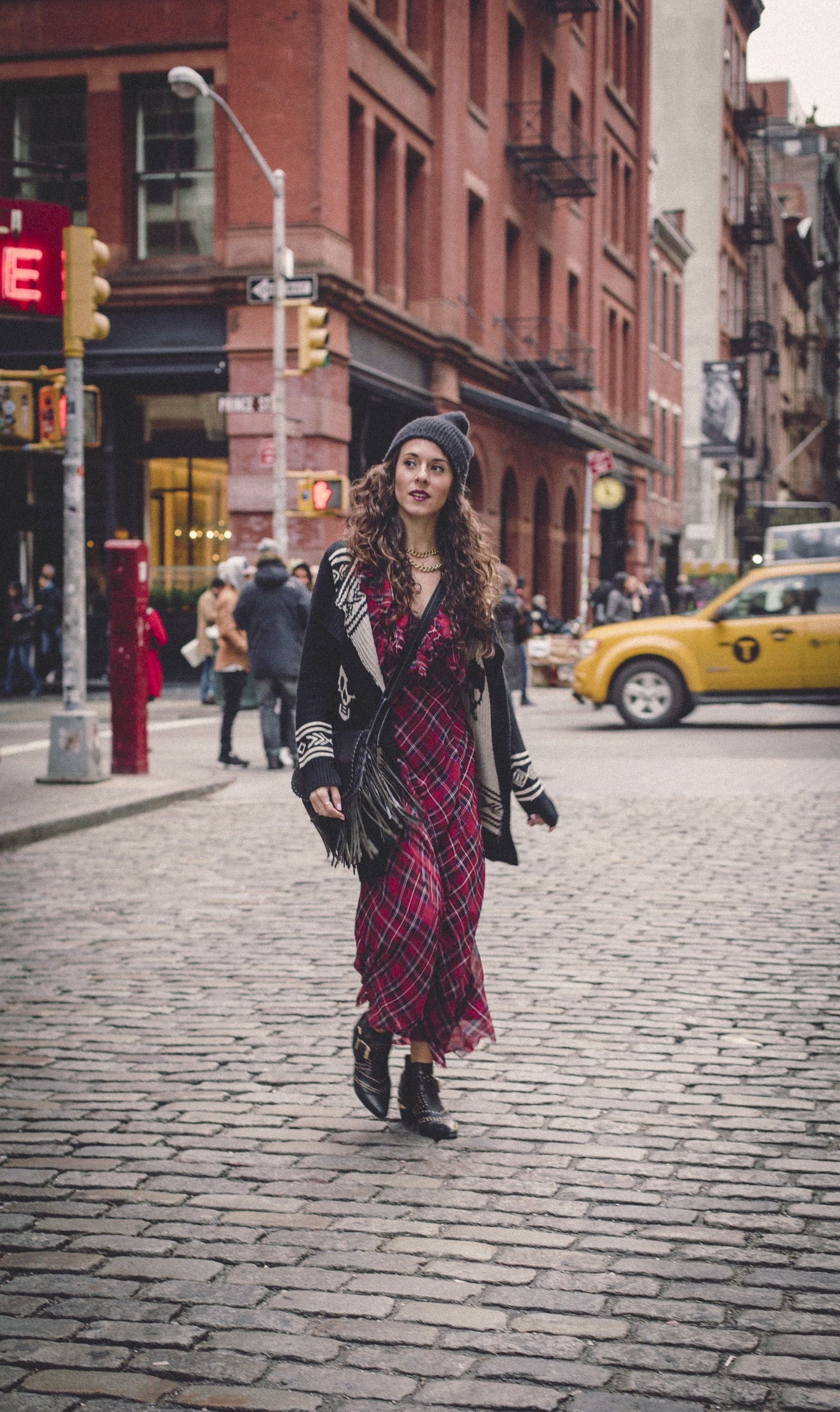 "Wearing the maxi tartan ""Venitia Dress"" by  Free People ,  Aldo  studded booties,  Rebecca Minkoff  fringe purse, and  Urban Outfitters  sweater and beanie.  Photography by  Francisco Graciano ."