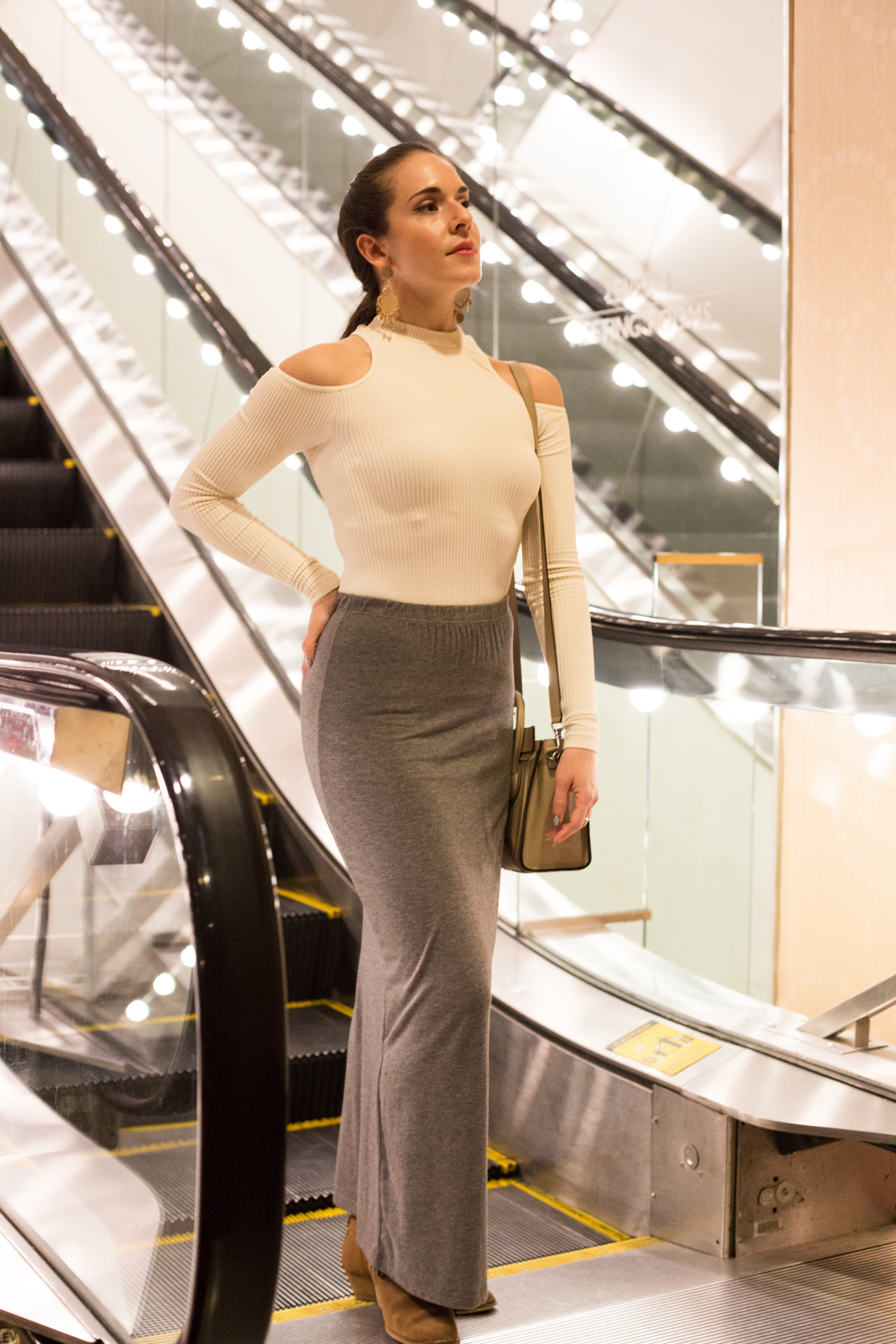"""At """"On Your Feet"""" Broadway wearing my  Celine  Nano Crossbody bag in nude,  Aldo  suede booties,  Brandy Melville  grey long skirt, Free People  """"Prima Ballerina"""" white top and earrings from Brazil. Photography by  Francisco Graciano ."""