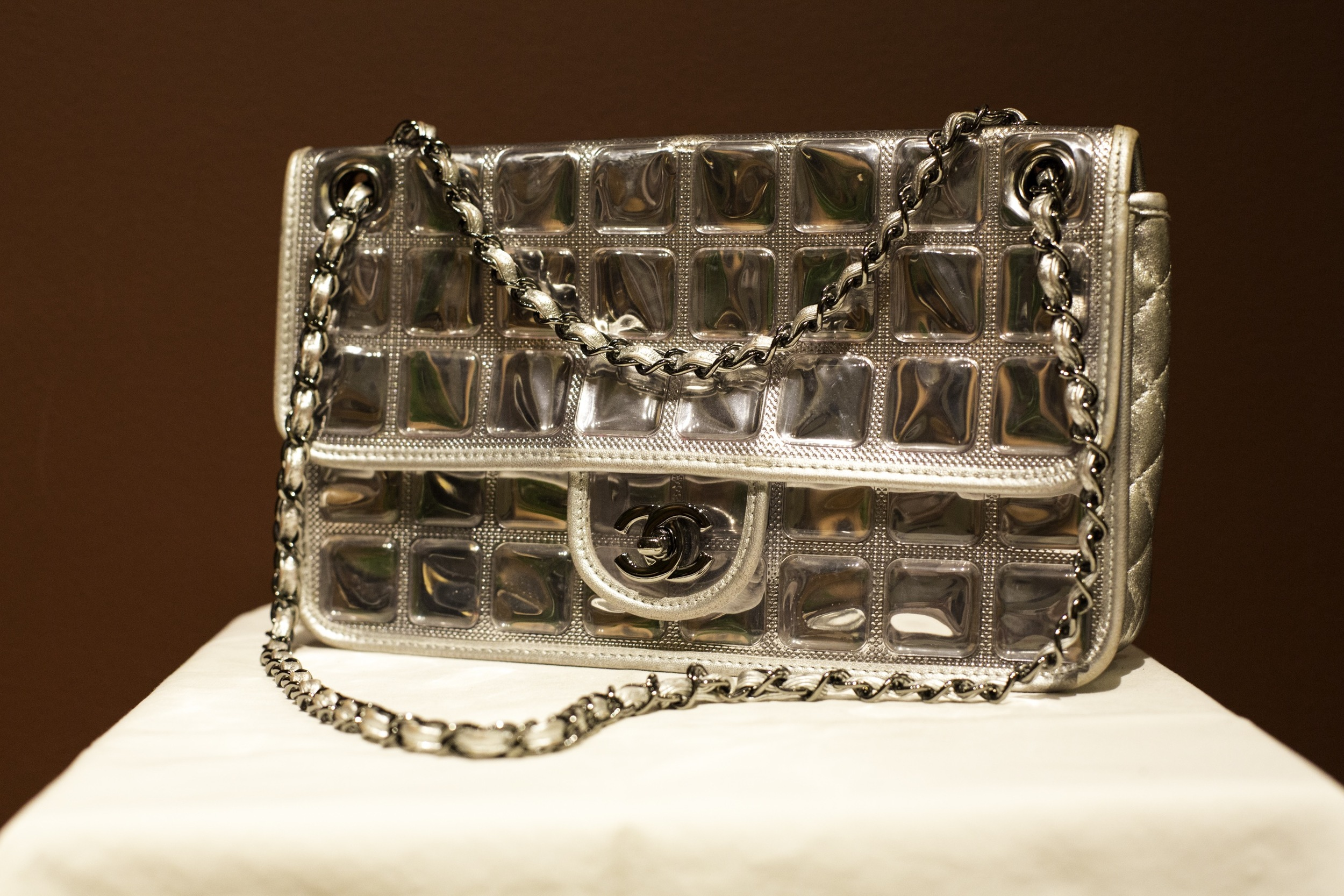 Here is my  Chanel  ice cube bag I bought in Europe years ago and I just treasure.  It's ice cube detail with metallic trim make the bag match really well with almost anything, and it's such a statement unique piece.  It was the perfect finish for a funky rock and roll look.