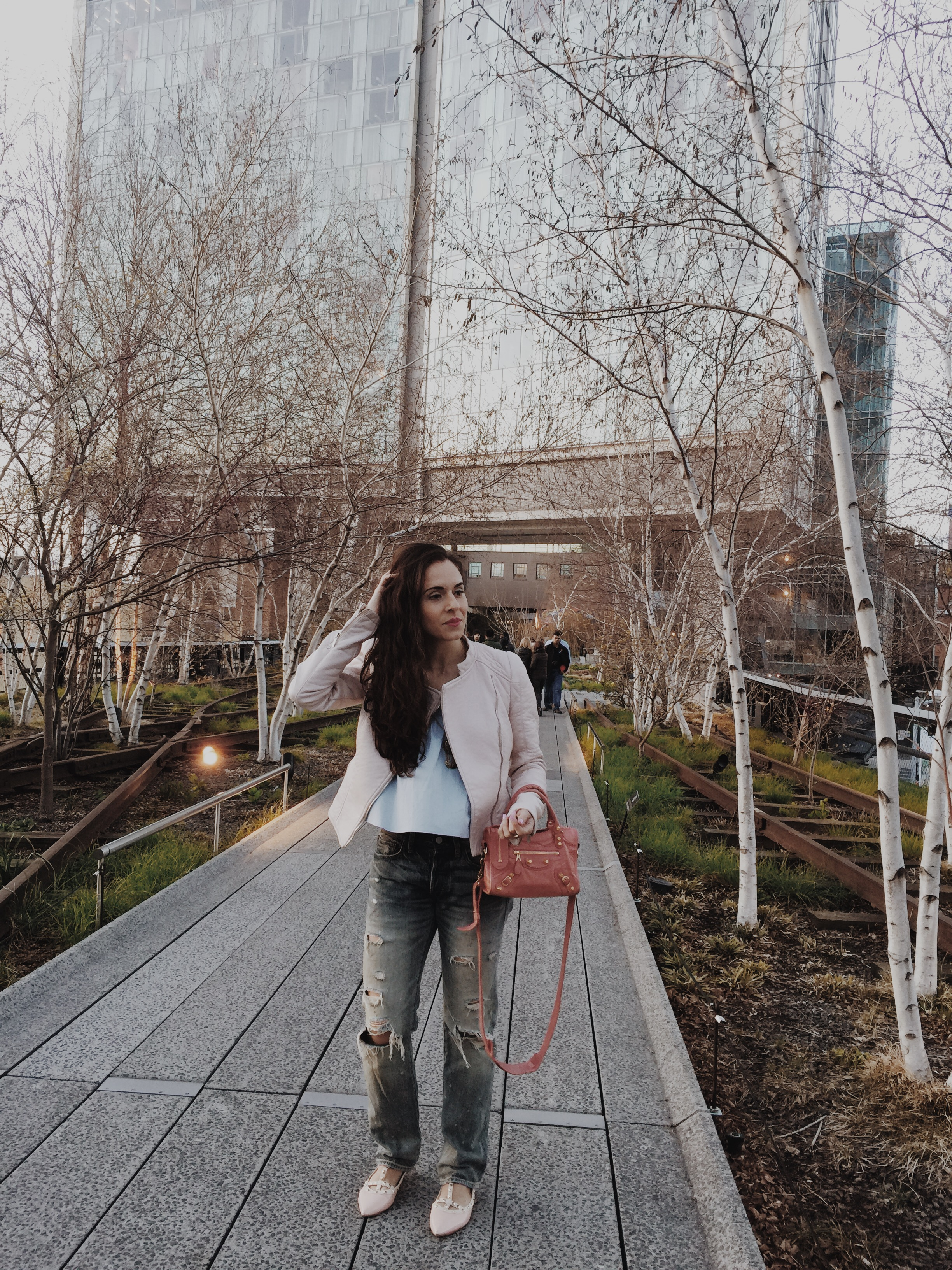 Strolling the High Line in the Meat Packing district in my  Zara  off the shoulder blue top and pink moto jacket,  Ralph Lauren Denim & Supply  ripped boyfriend jeans,  Valentino  rock stud flats, and  Balenciaga  Mini City bag. Photography by  Francisco Graciano .