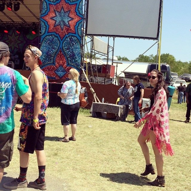 Walking the Strange Creek festival last year wearing a Free People fringe kimono, Aldo studded ankle booties, and Express cutoff black denim shorts and H&M black crop top.