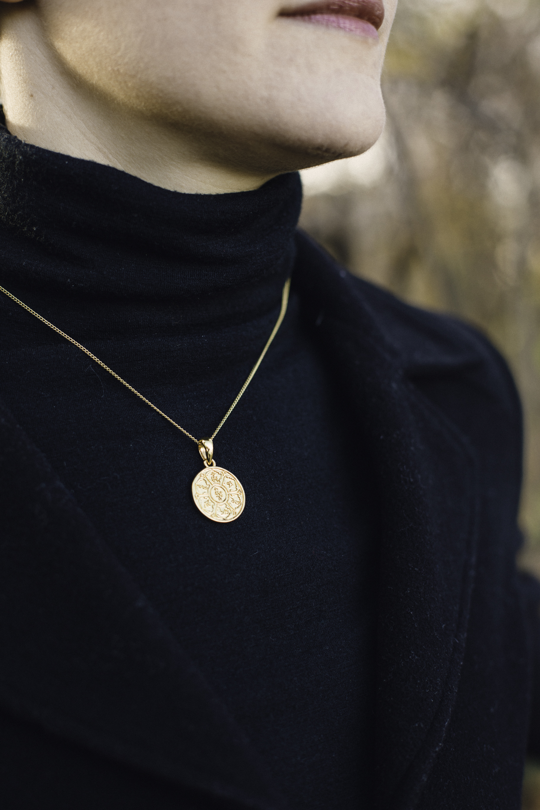 My best friend Samantha in the gold plated brass Om Mani Padme Hum Pendant. Photography by  Francisco Graciano .