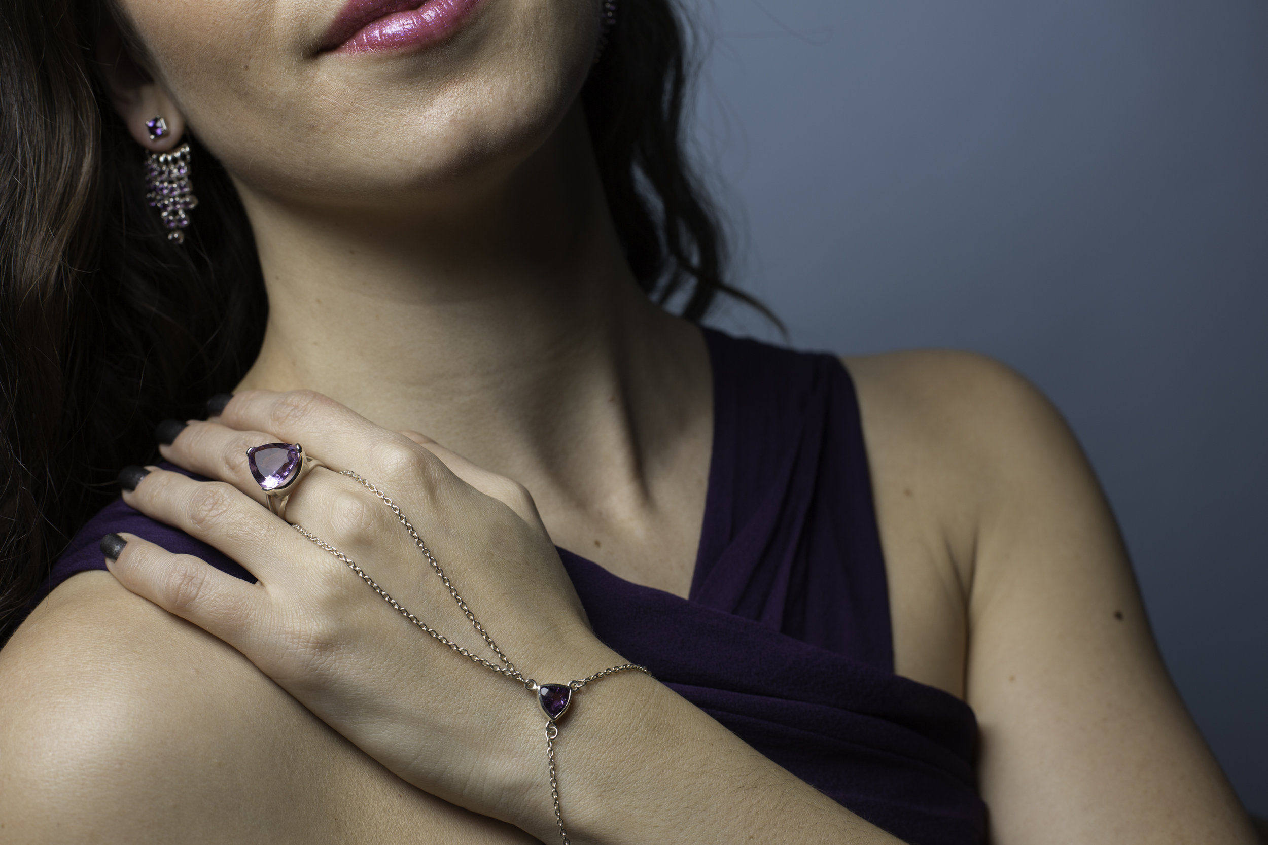 Wearing Made in Earth Collection Amethyst bracelet and ring as well as earrings. Please see below for the healing and energetic properties of Amethyst.