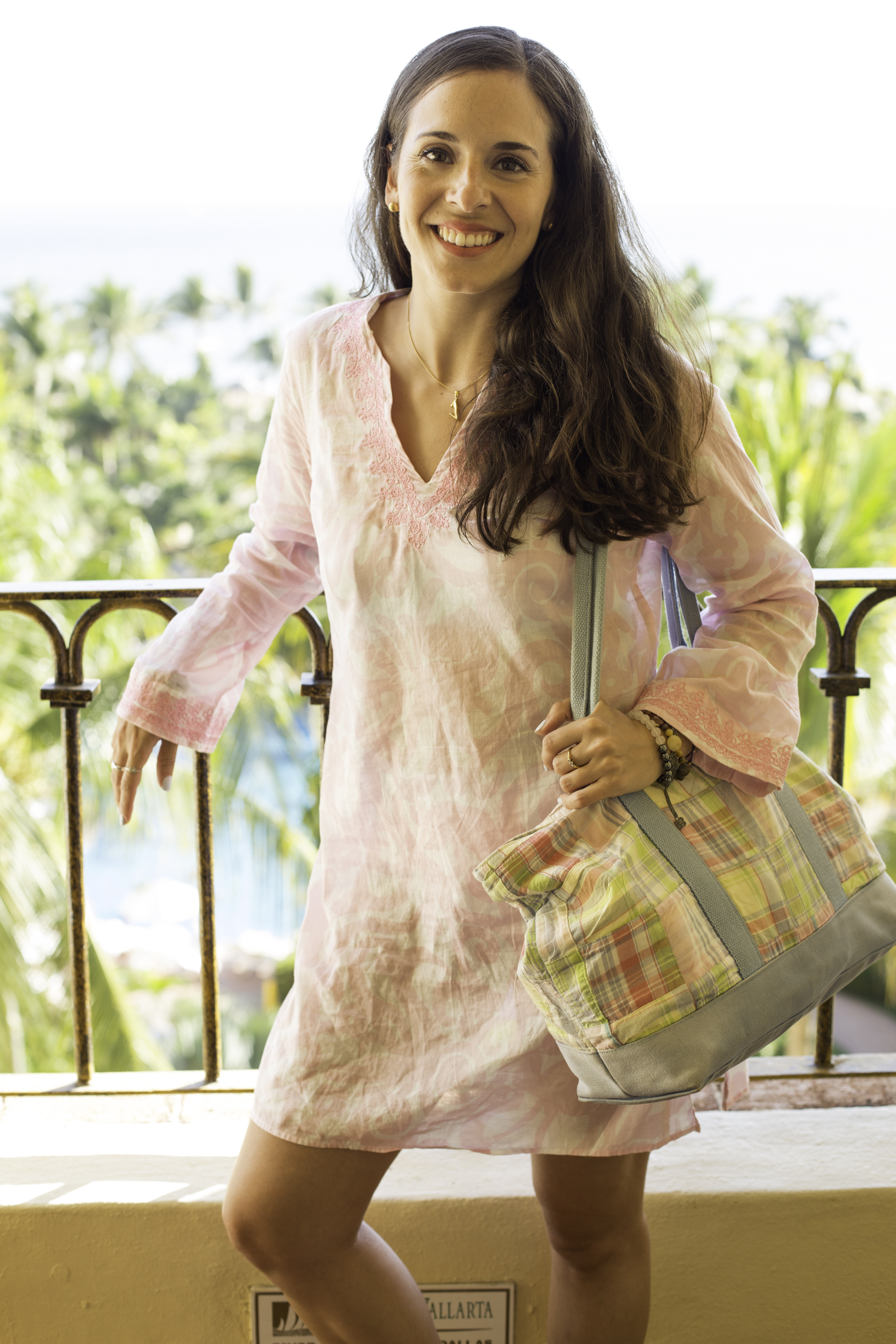 In my  Lilly  tunic,  Havaianas , and  Vera Bradley  beach tote on a vacation in Mexico. Photography by  Francisco Graciano .