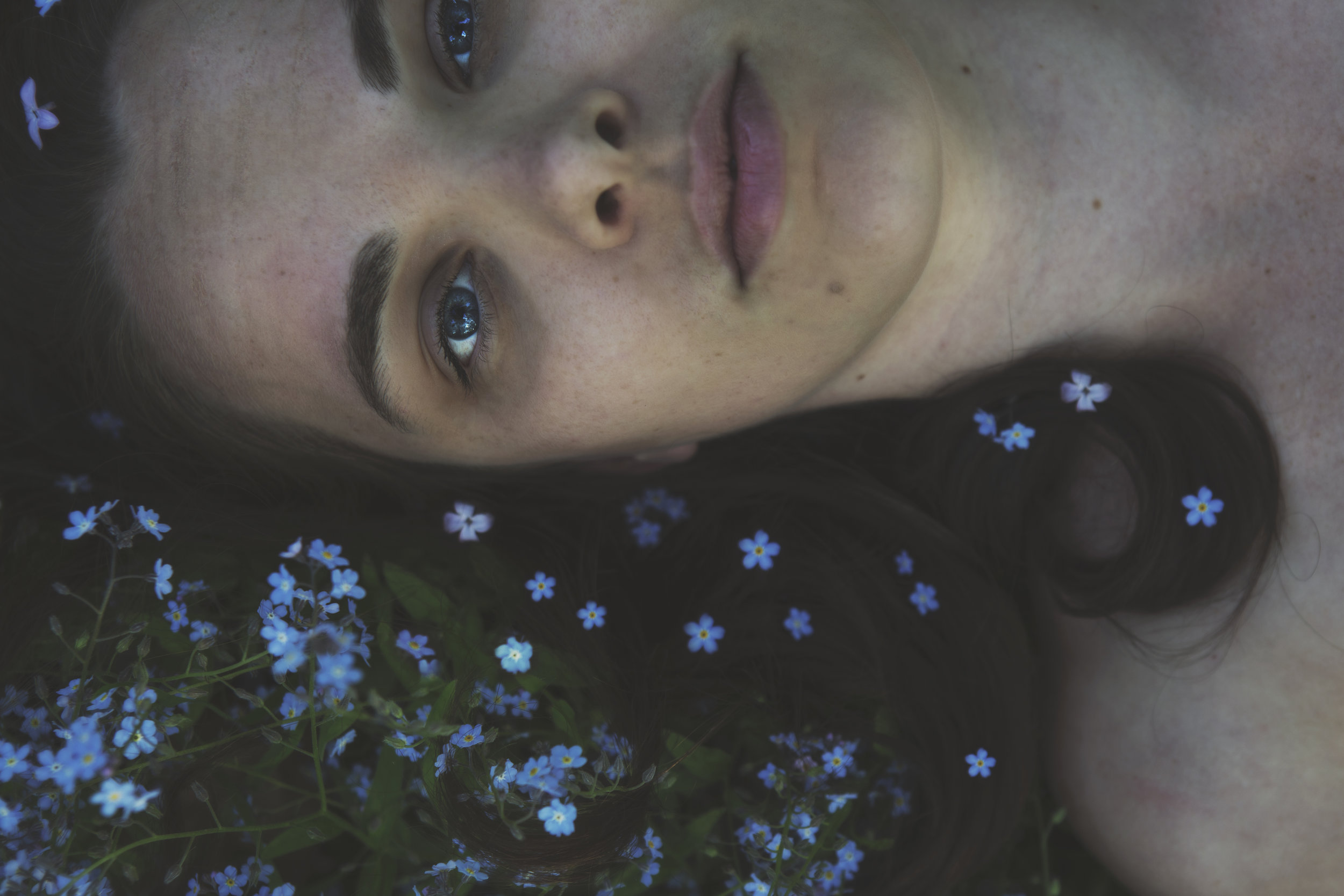 A girl in a bed of flowers