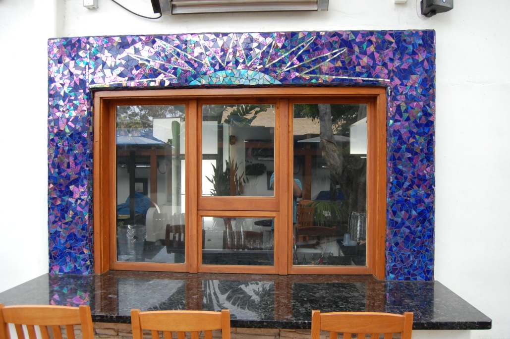 Eos, Wrap around bar   .    2007 Stained glass & mirror.  Cement grout.