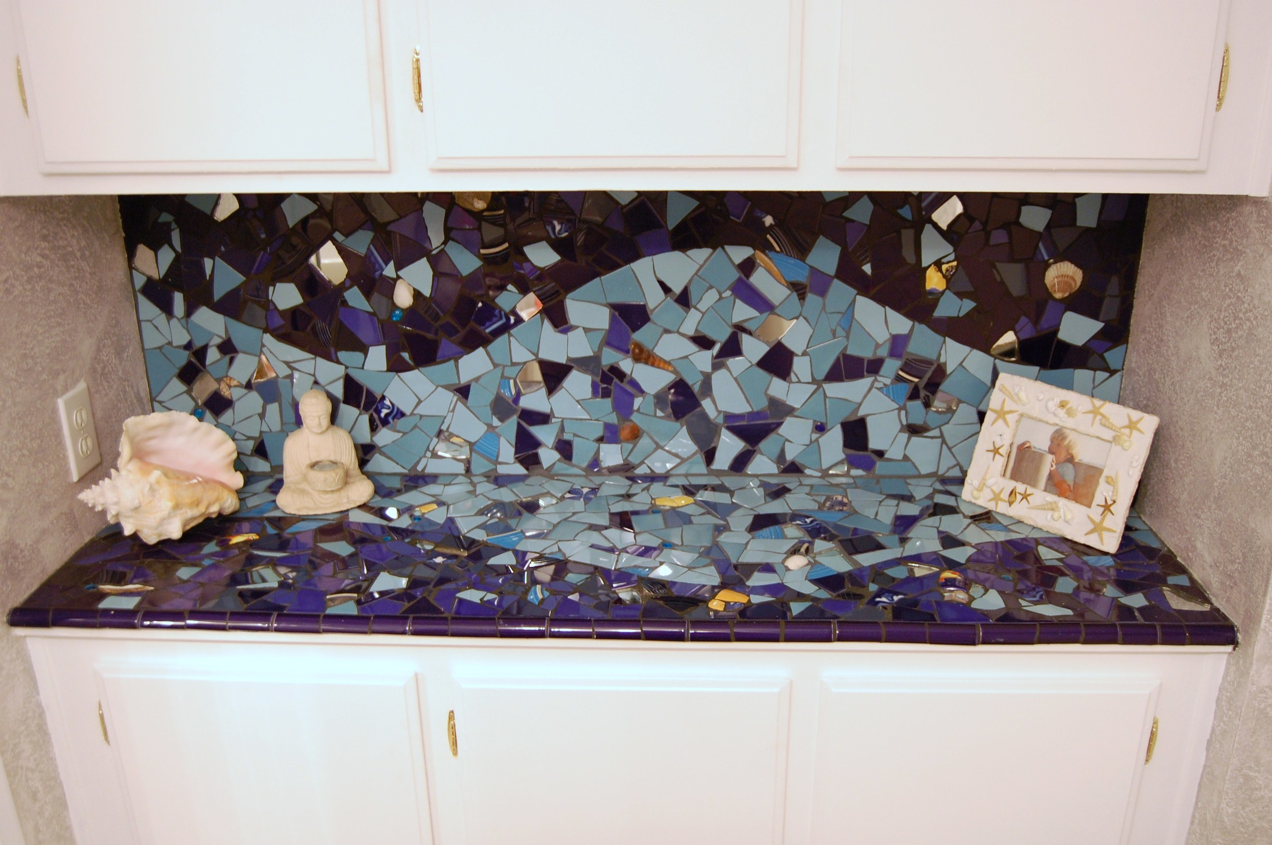 Residential bathroom.     Ceramic tile, mirror, shells and found objects.  Westlake Village, CA.  2008