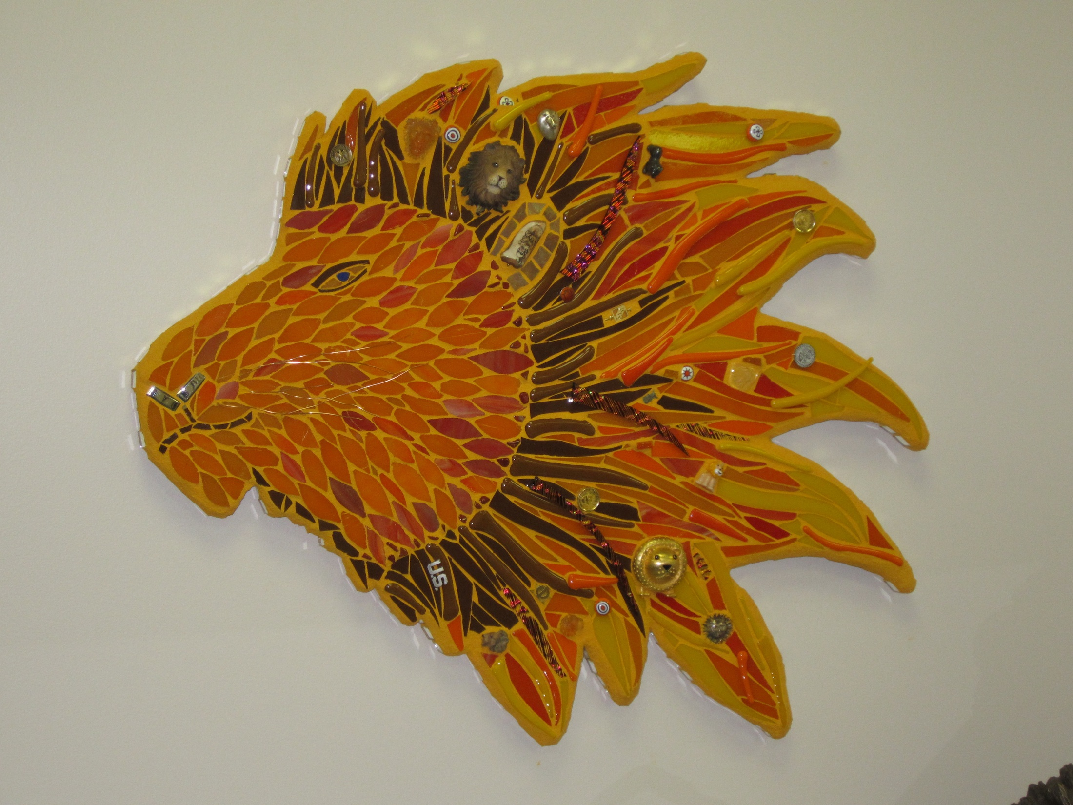 "A Lion for Me?    2014 Stained glass, glass fusions, sentimental pieces, millefiori, mirror, tinted mortar and grout. 30""x16"""