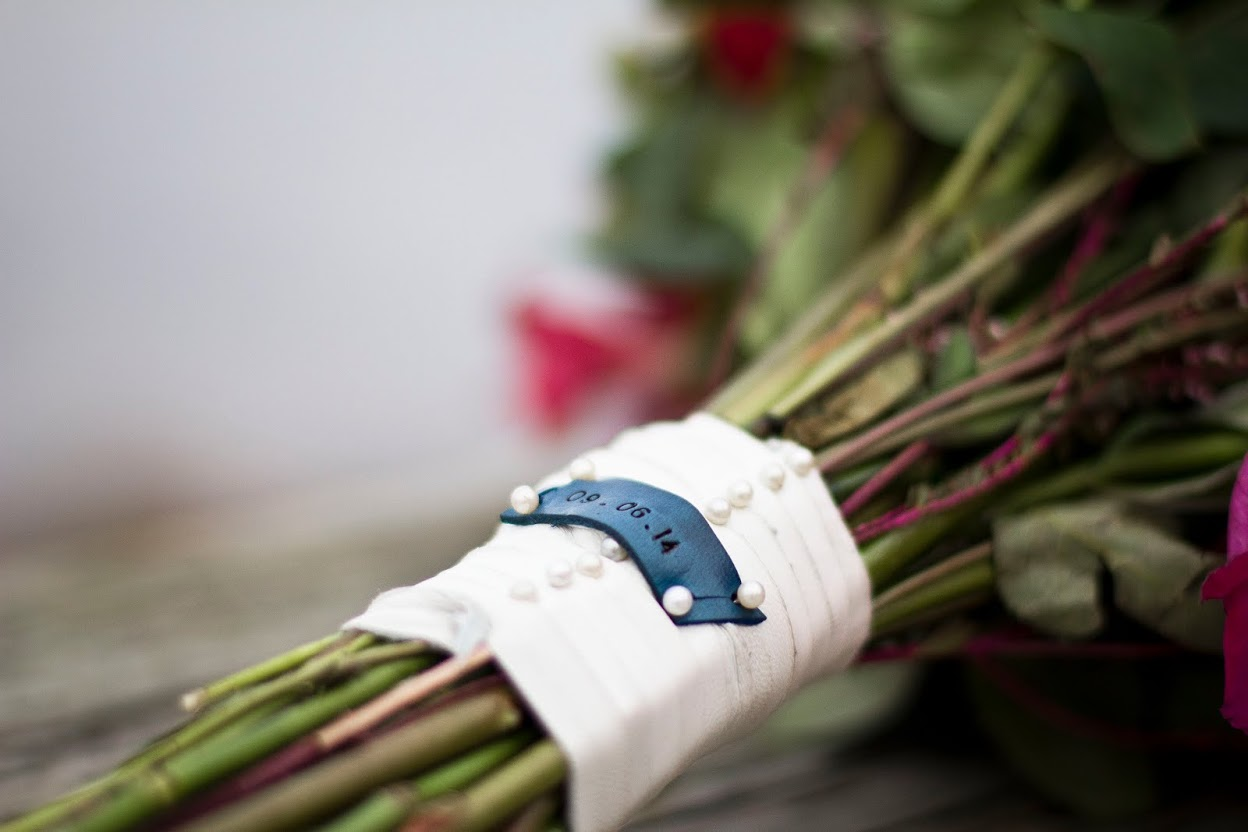 Bouquet with jewel-embellished leather wrap