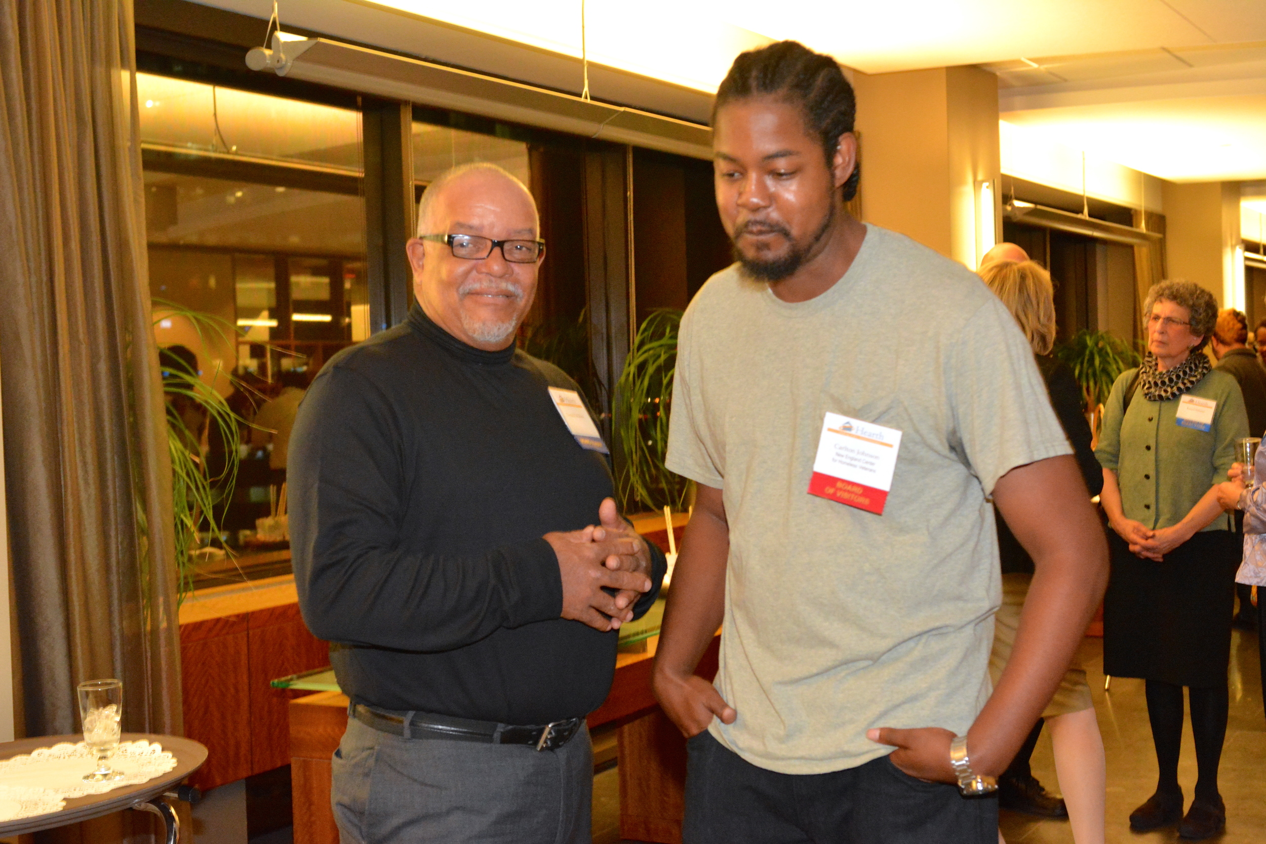 Hearth Board member Ray Walden (left) with former Outreach Case Manager and current Board of Visitor member Carlton Johnson.