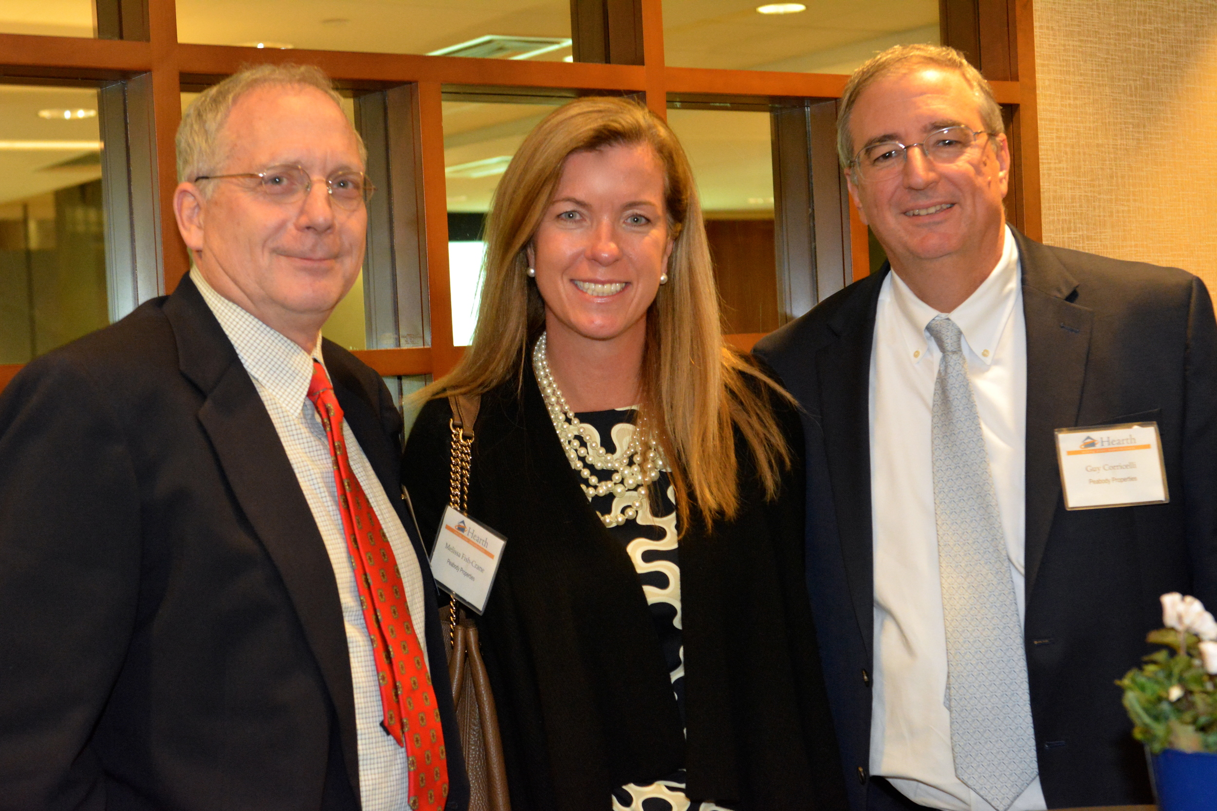 Hearth Board Member Bob Bickford (left) with Melissa Fish-Crane and Guy Corricelli of Peabody Properties.