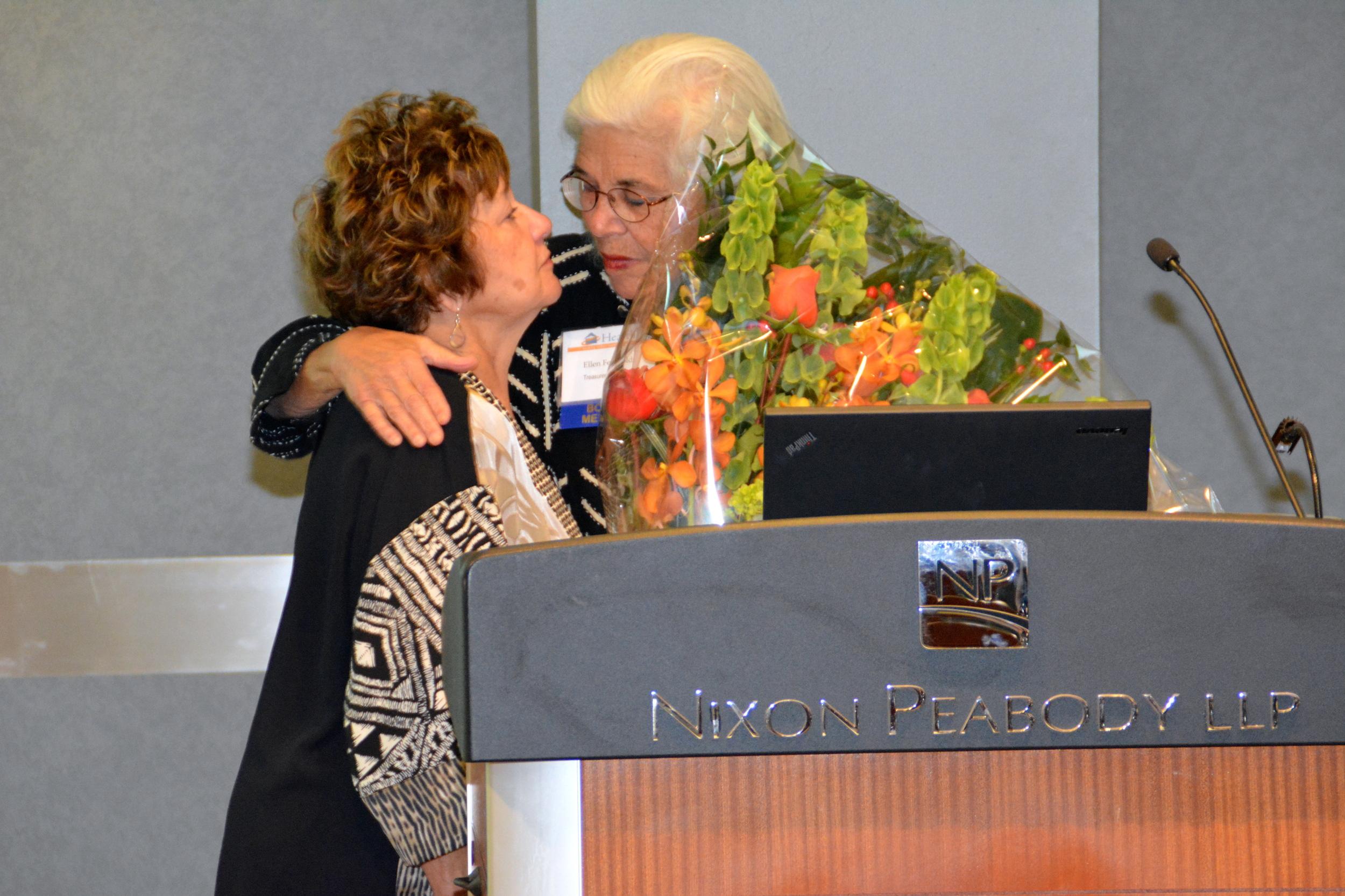 Ellen presents Kathy with flowers.