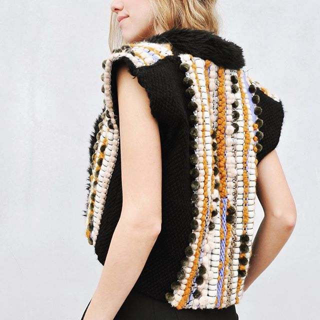Personal favorite 😍 #christinekopper #weaving #scadfibers #textiledesign #outerwear #fashion #fibers #pompoms #ihavethisthingwithpompoms #handmade #woven #fiberart #weaver #weaversofinstagram