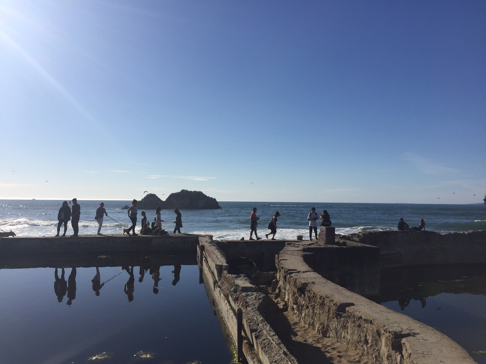 Visitors walking the Sutro Bath ruins