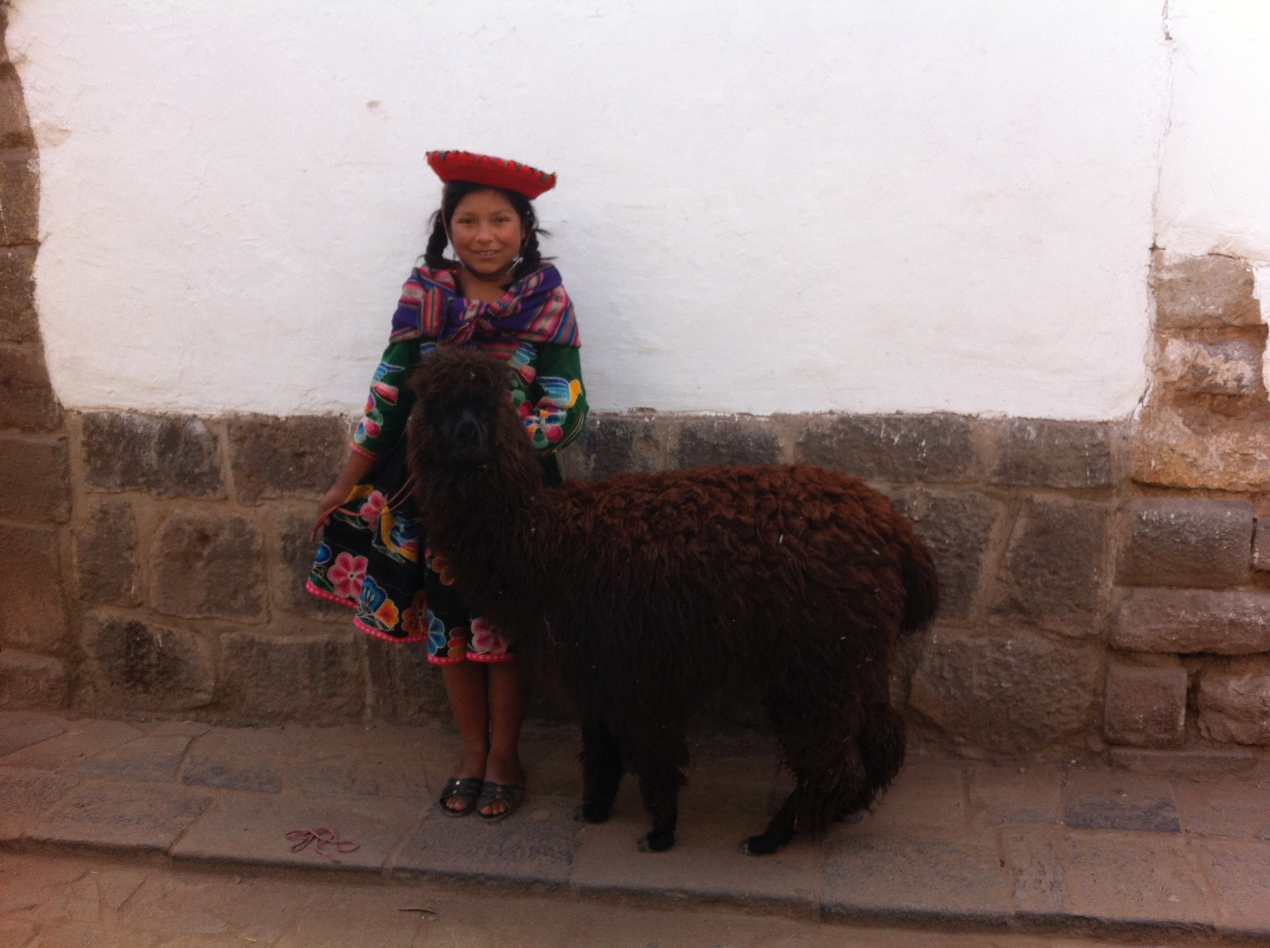 Running a business of posing for tourists in Cusco.