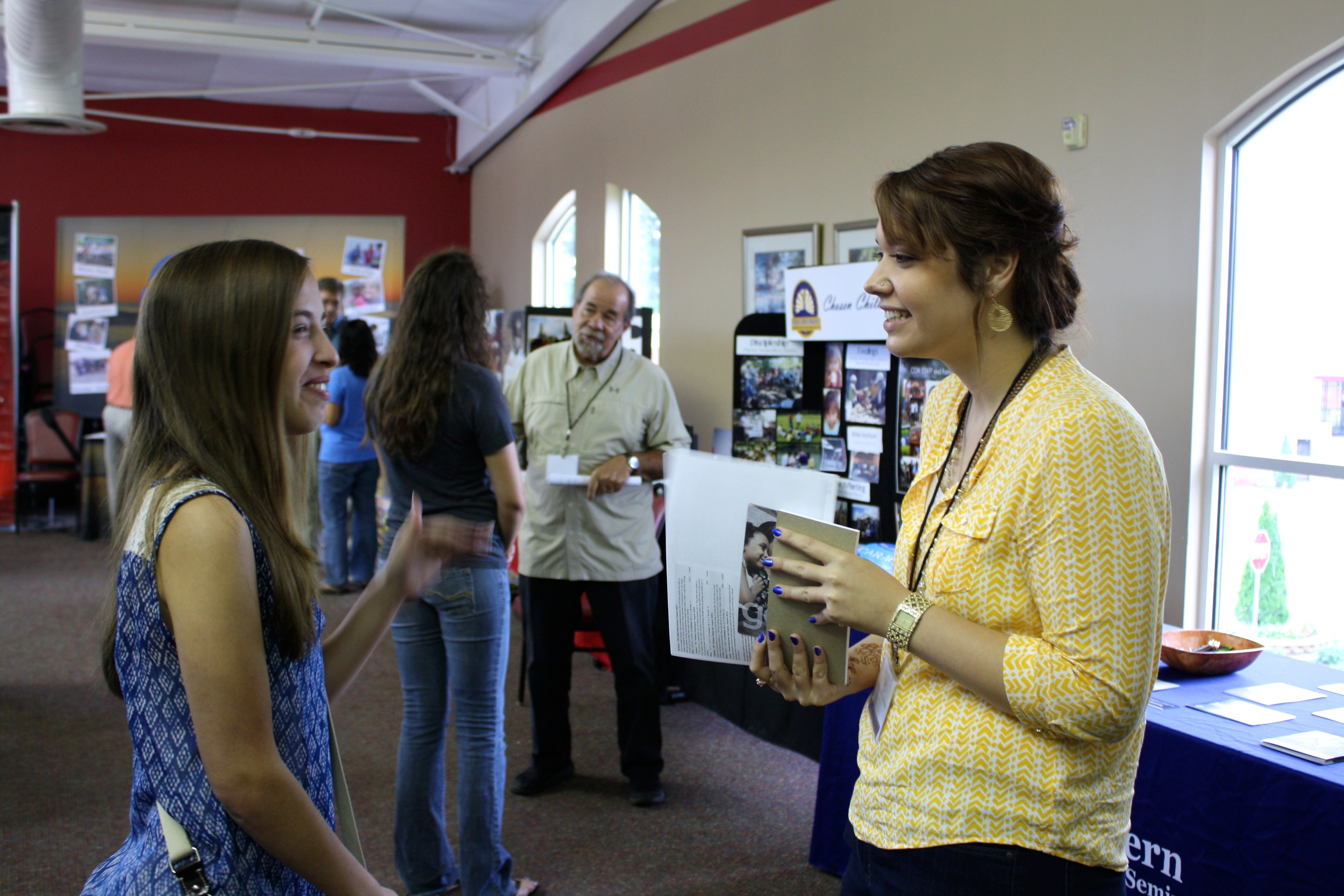 A student and a missionary laugh together during NGU's global missions week September 8-10.