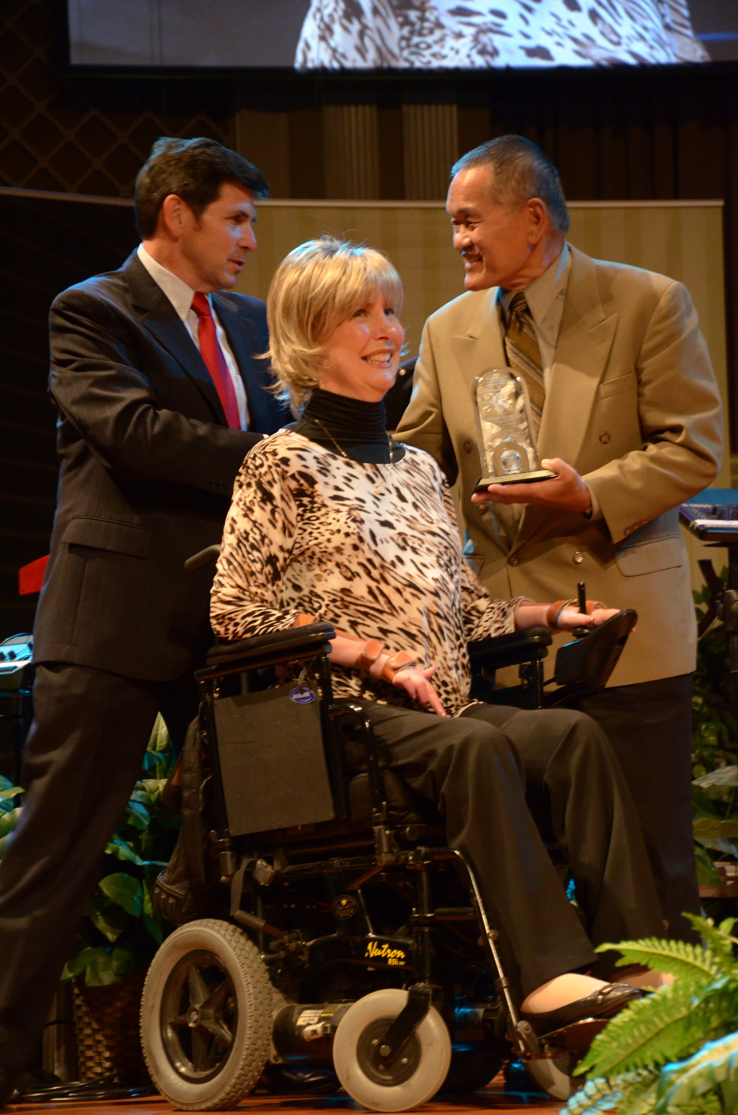 JoniEareckson Tada, along with her husband Ken, receives an award from theDirector for Christian Worldview and Apologetics at North Greenville University.,Alex McFarland at the TNG conference in Spartanburg.