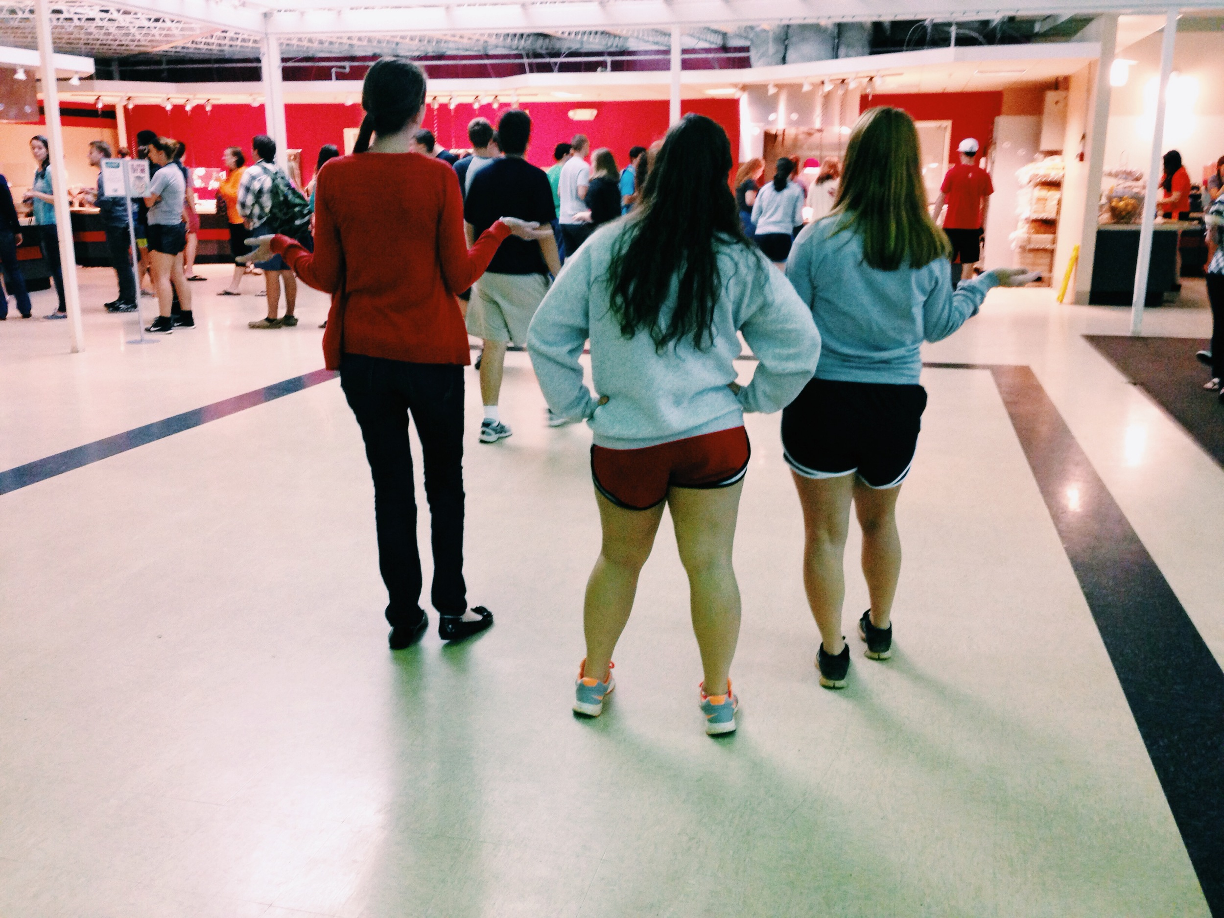 Courtney, Mandy, and Kaitlyn search for the fastest moving caf lines.