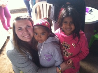 Halie poses with some little girls from a village she worked in.