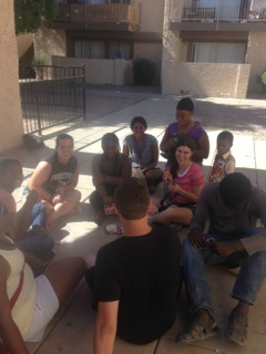 Mandy plays Uno with a group of African refugees, which gave her opportunities to share the Gospel.
