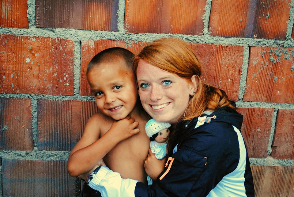 Kaitlyn loves on a Gypsy child in one of the villages she went to.