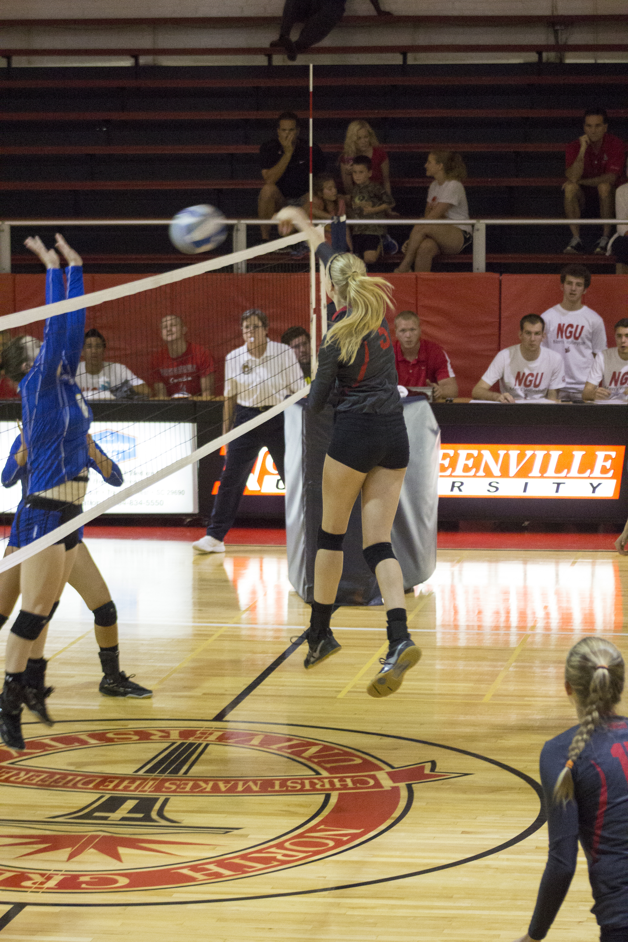 Junior Taylor Dupes returns with a spike on the opponent's side.