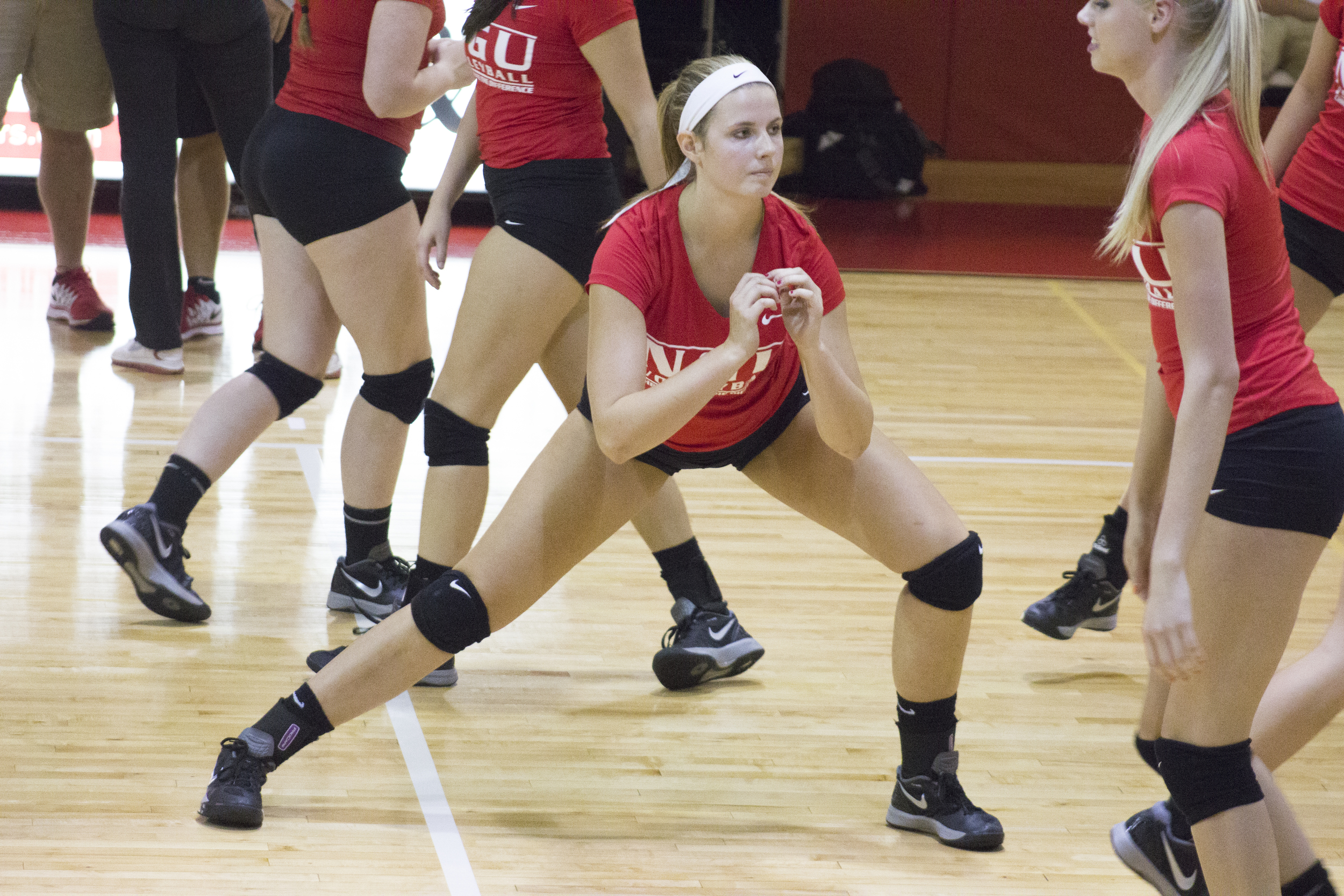 Sophomore Sommer Cagle stretches prior to the match.