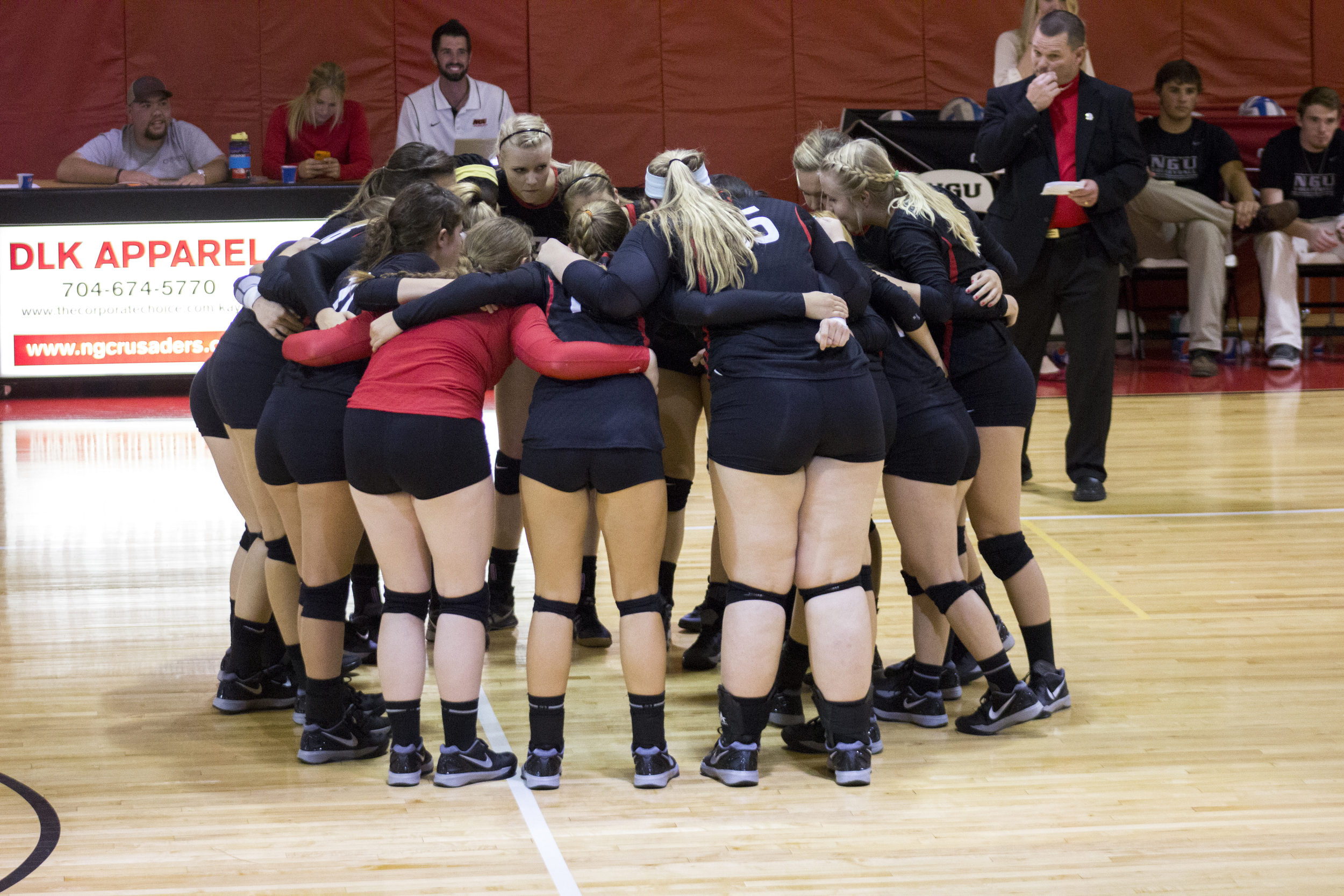 The team huddles up before the start to another match.