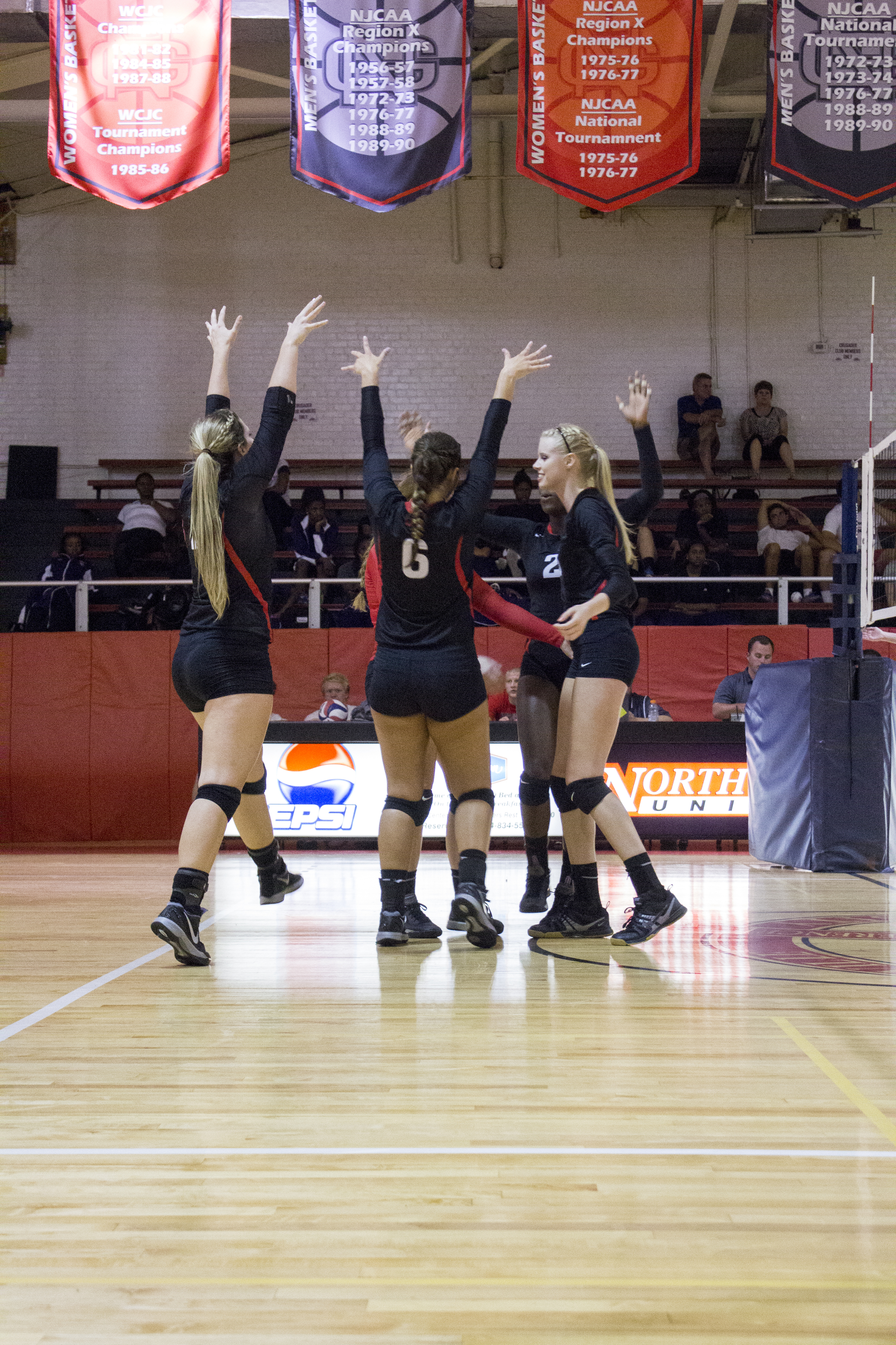The team celebrates a victory over a hard fought point.