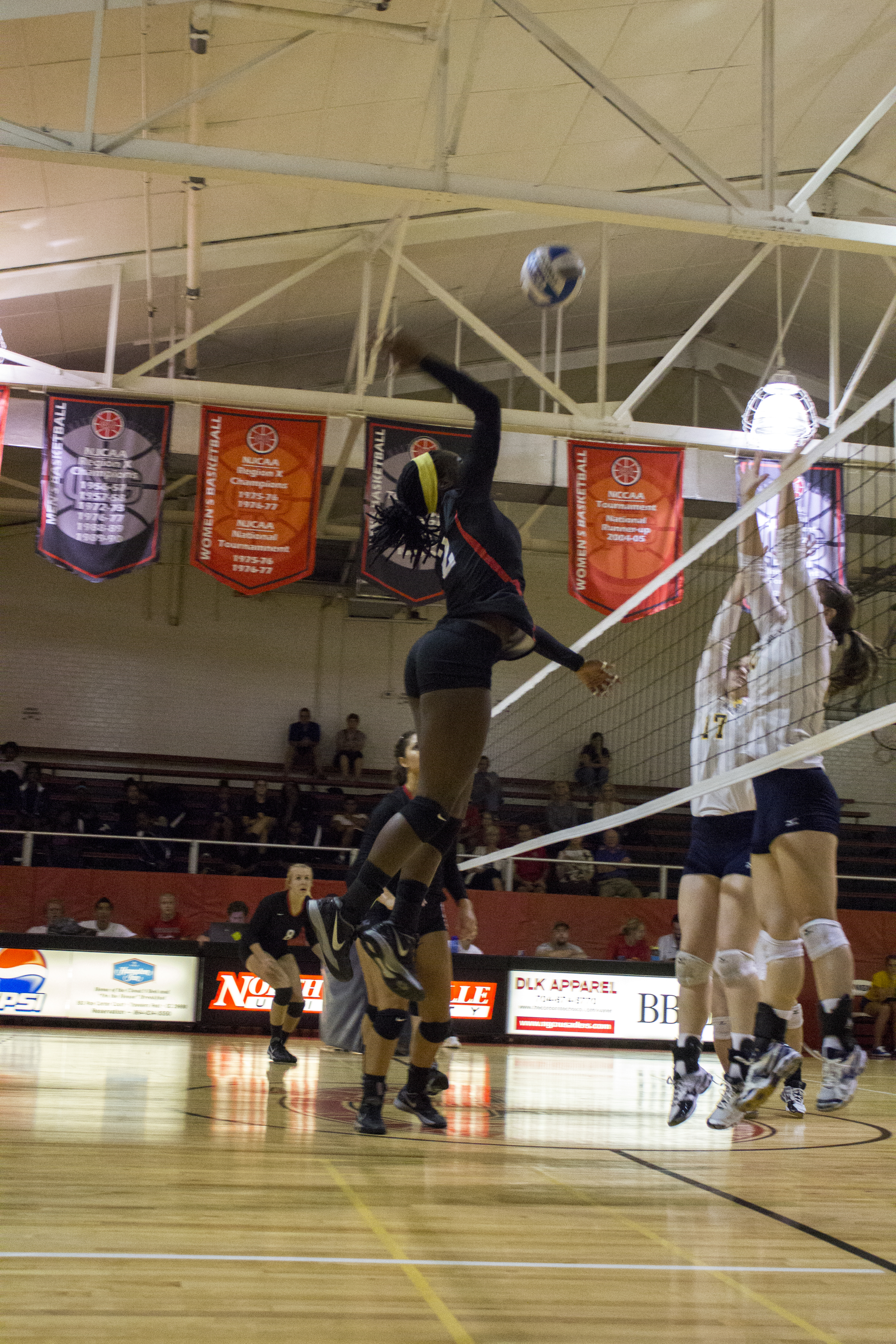 Junior Yomi Adeyeye jumps up to deliver a spike.