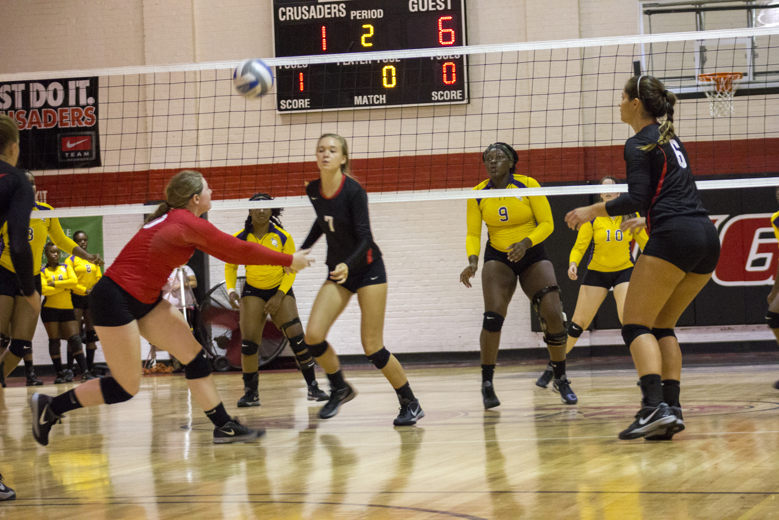 Junior Hannah Lewis bumps the ball to awaiting sophomore Haley Hester.
