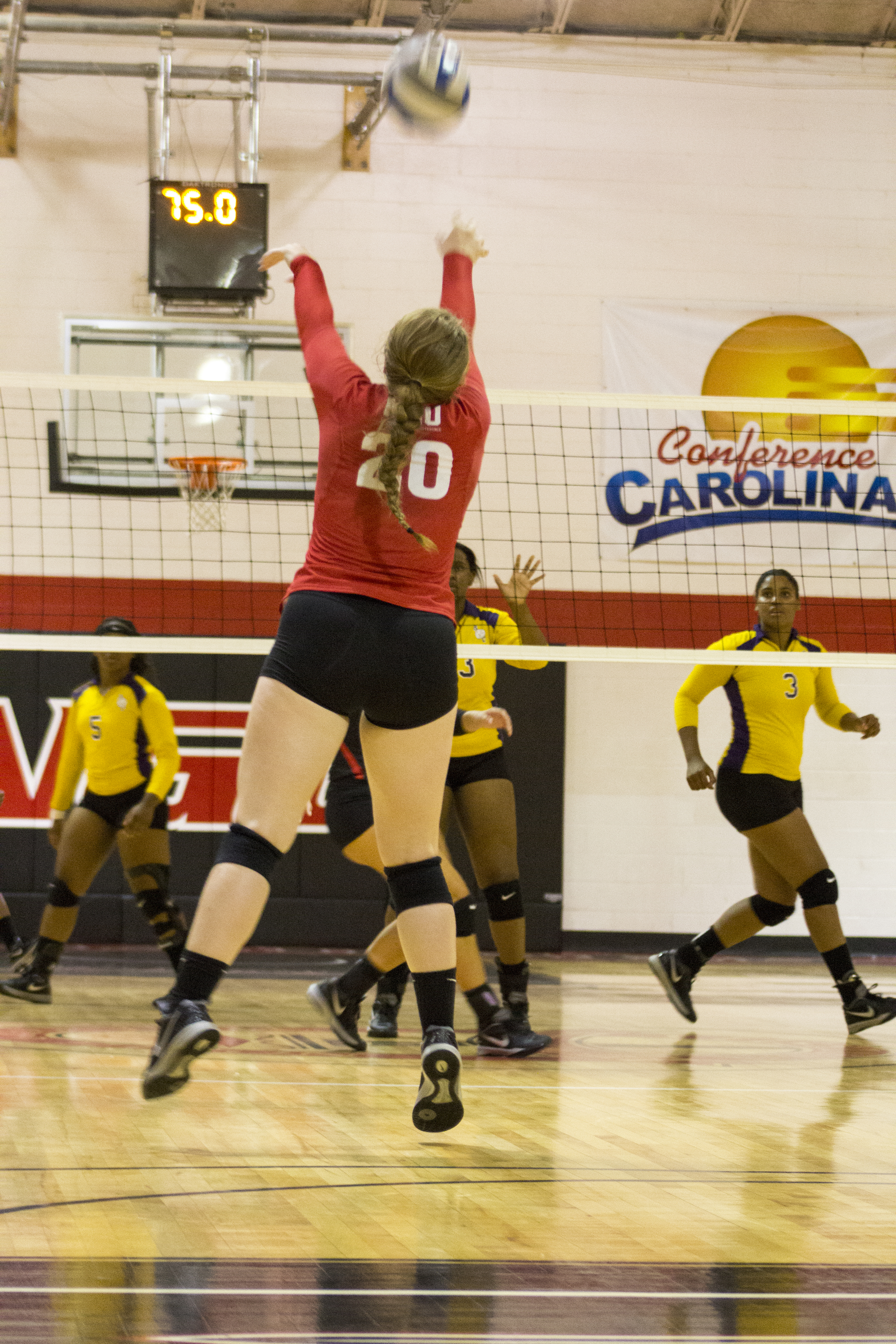 Junior Hannah Lewis jumps up to forward set the ball for her teammates.