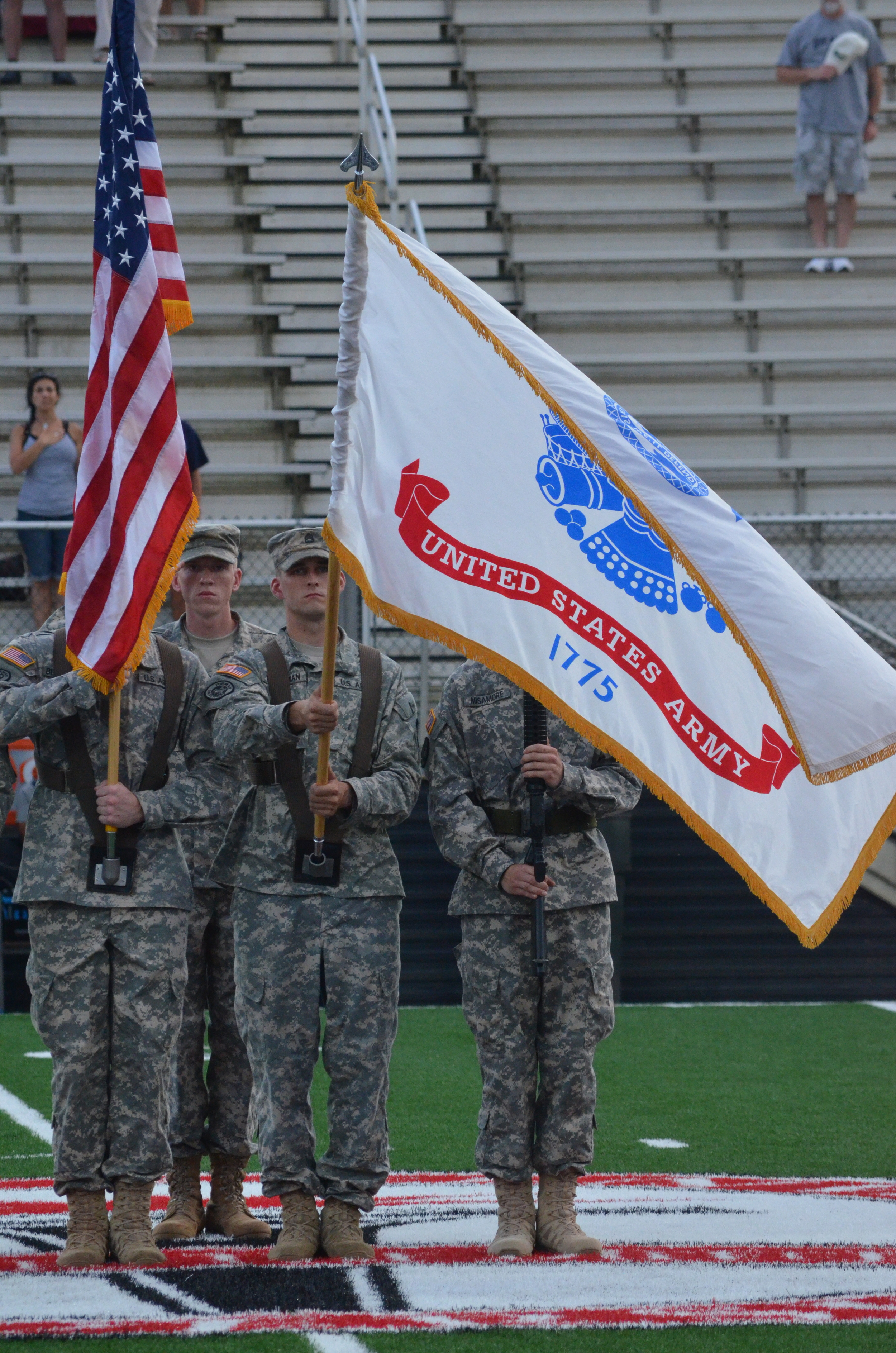 The Color Guard presents the American and US Army flags before the game starts.