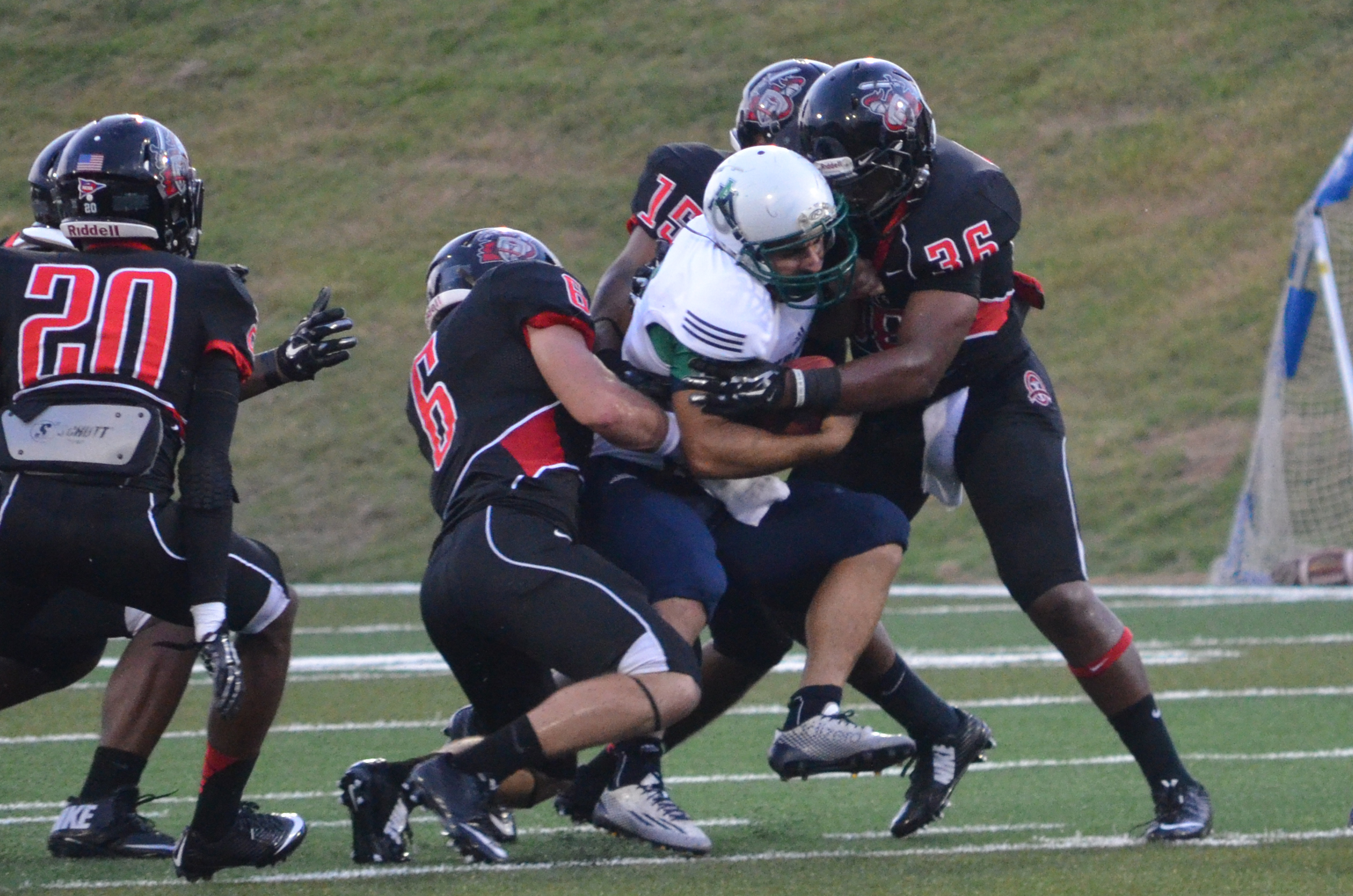 Taylor Anderson and Jalen Hammett work together to tackle an opposing team member