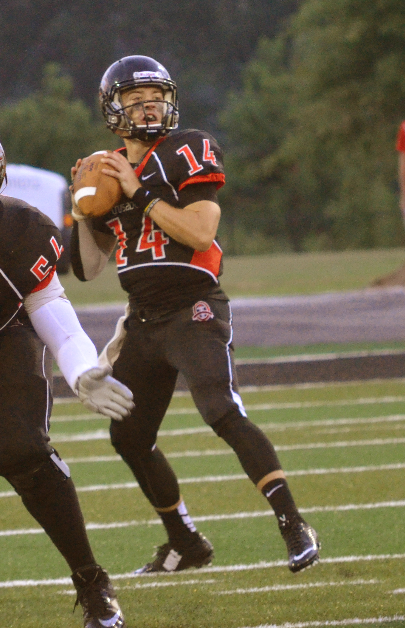 Quarter Back, Nelson Hughes, gets ready to throw the ball to the other side of the field