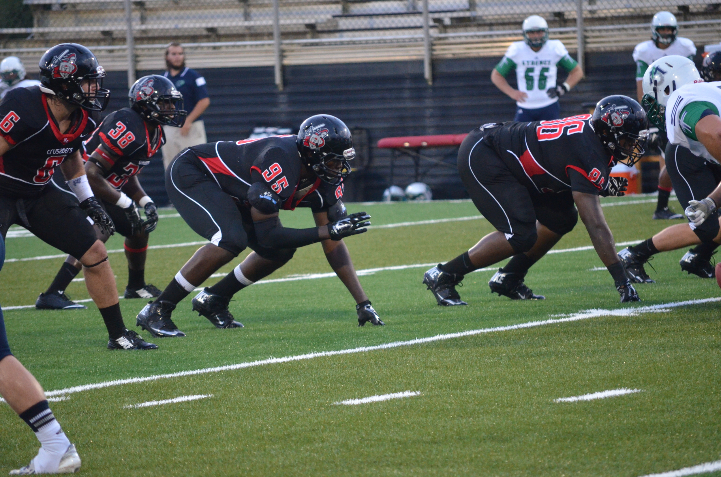 The team is ready on the line of scrimmage about to start the next down