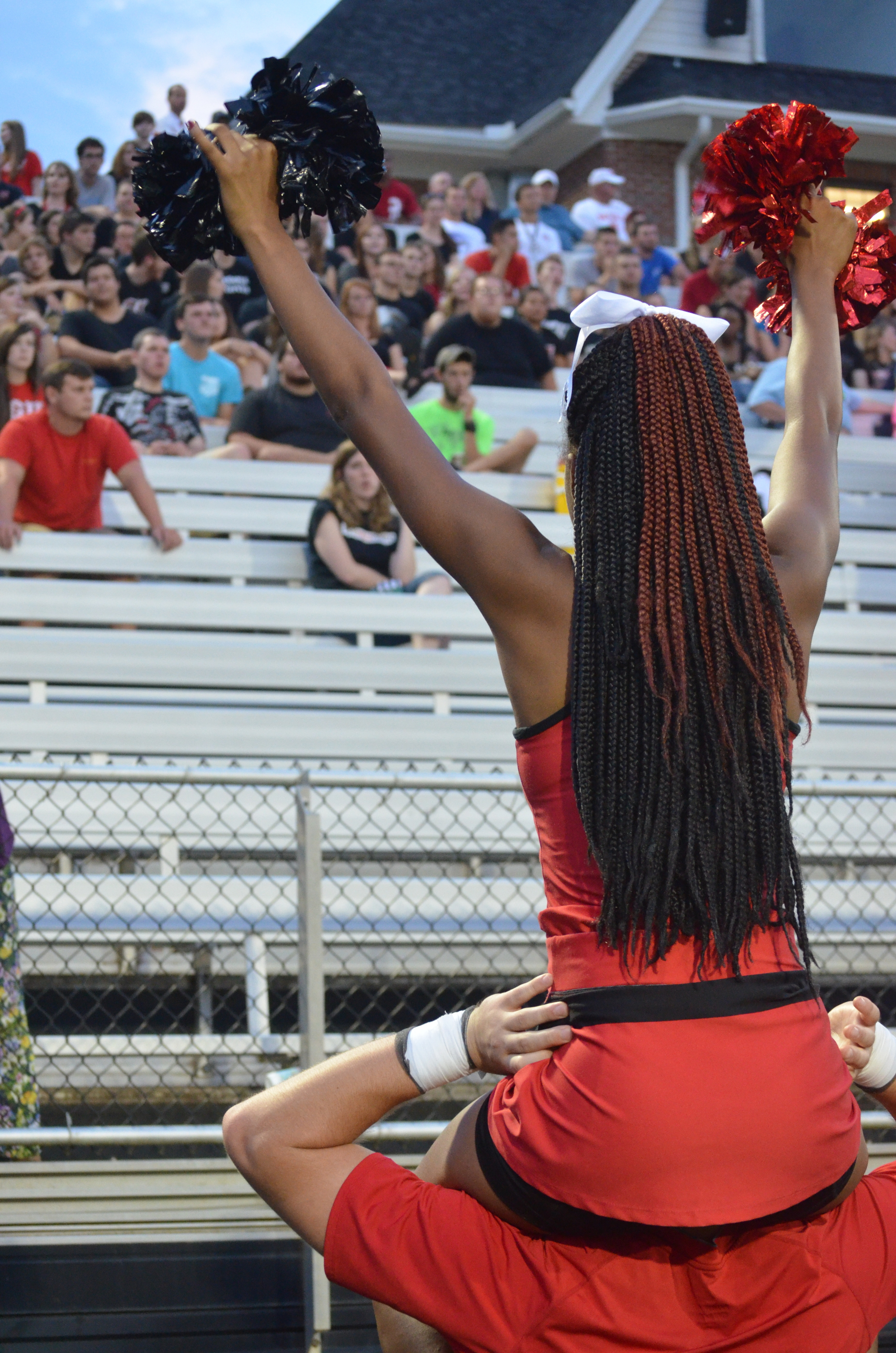 Cheerleader, Jay Whetstone, encourages the crowd to root for the Crusaders