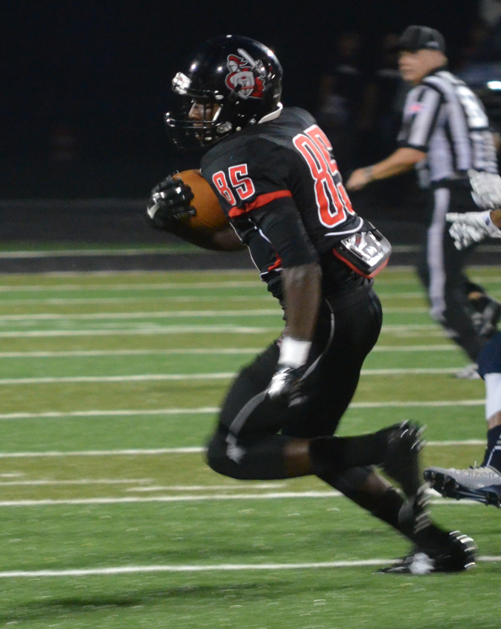 Wide Receiver, Robbie Brown, makes a run for the endzone while dodging the other team