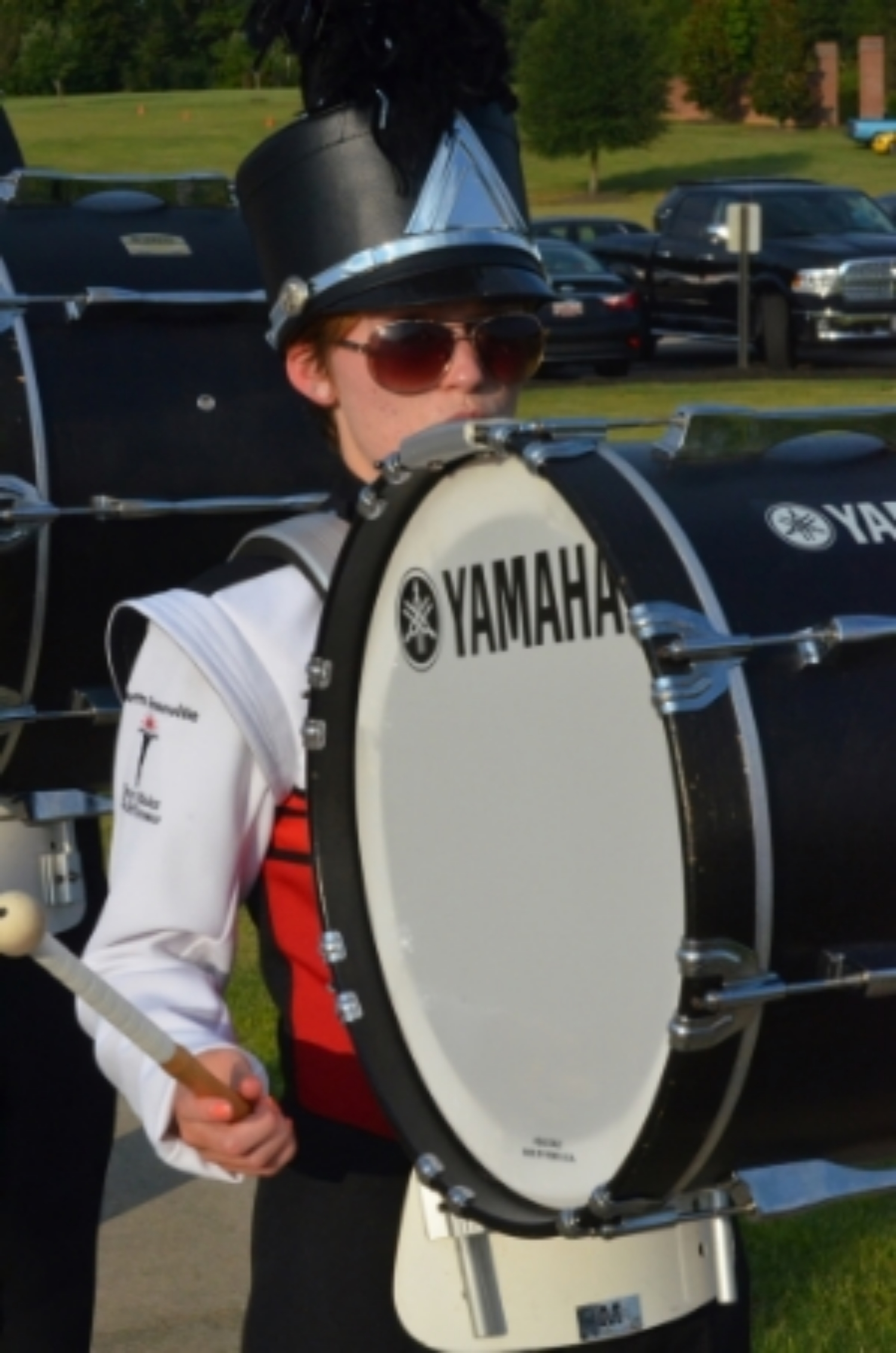 Band member plays before heading into the stadium