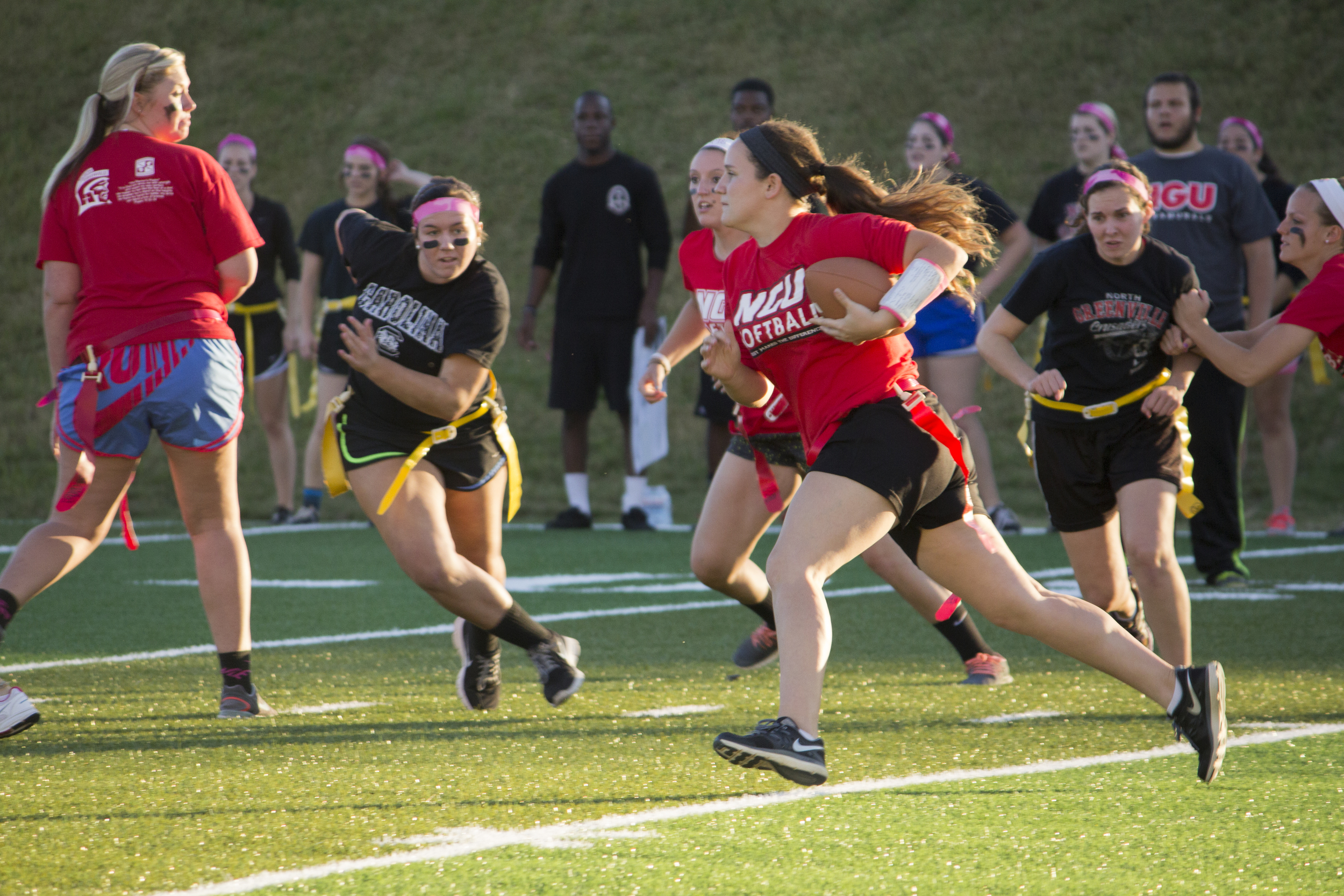 Senior Cassi Carpenter runs down the field in attempts to gain a first down.