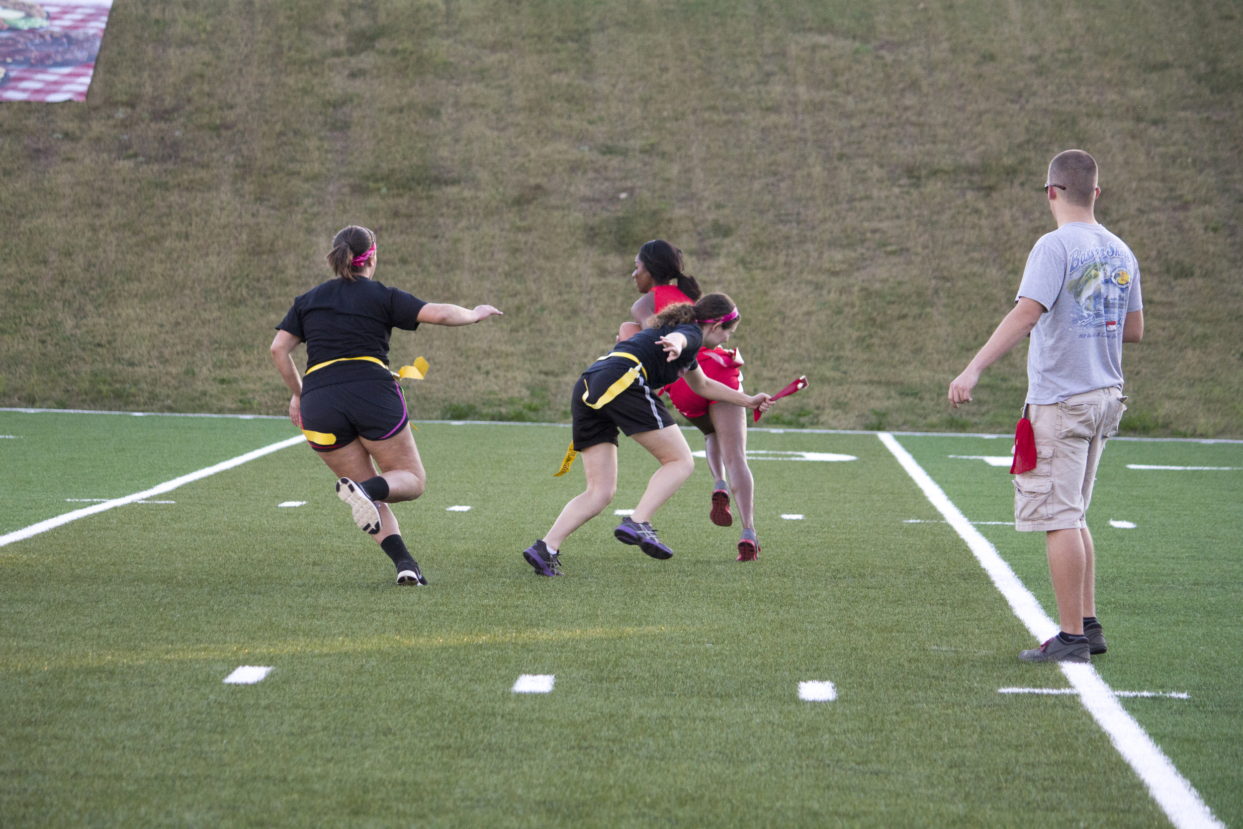 Junior Rachel Alley pulls the flag and snuffs out the Senior team's play before it can even begin.