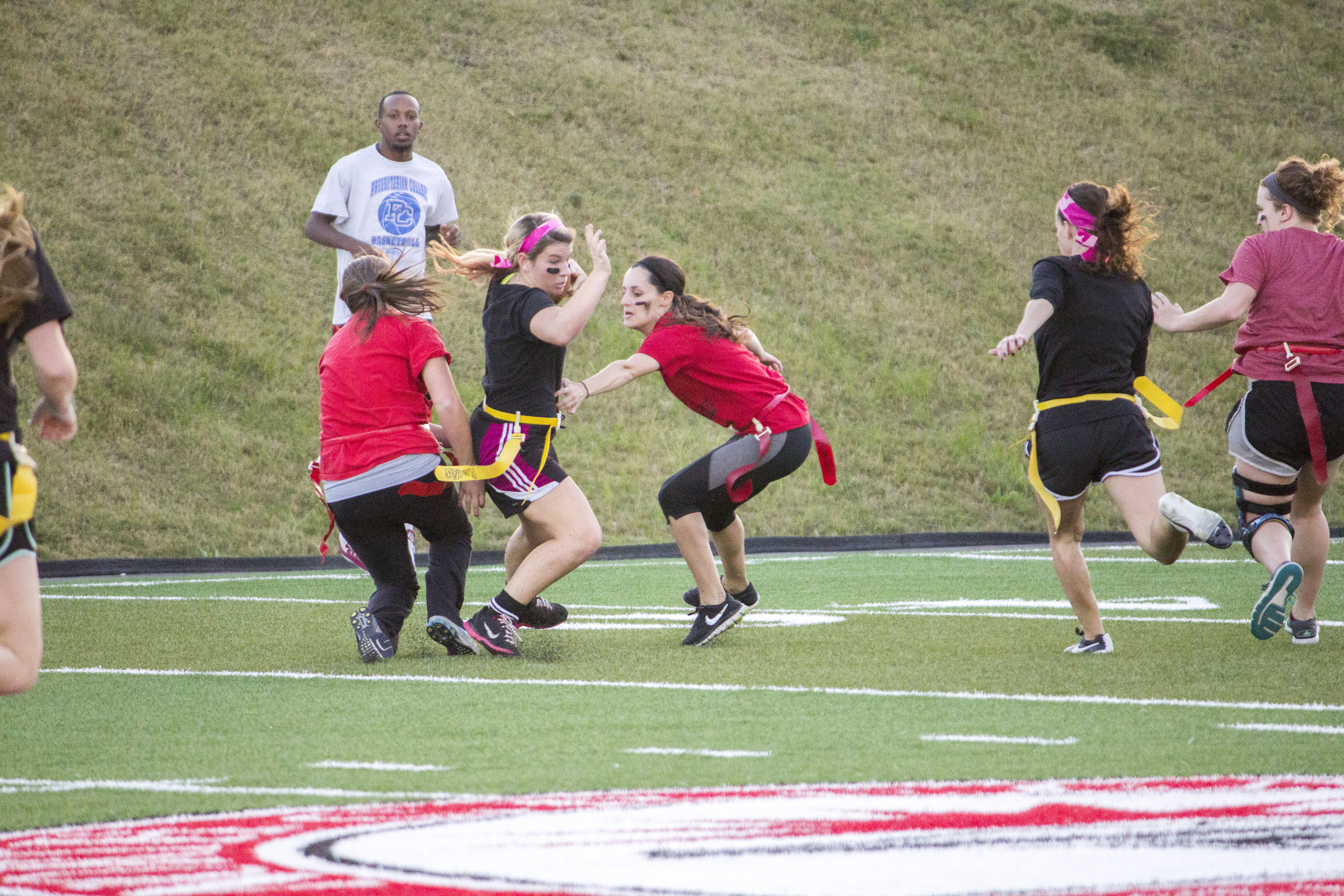 Junior Alexandria Cloer uses her footwork to step to the side to avoid her flag from being pulled.