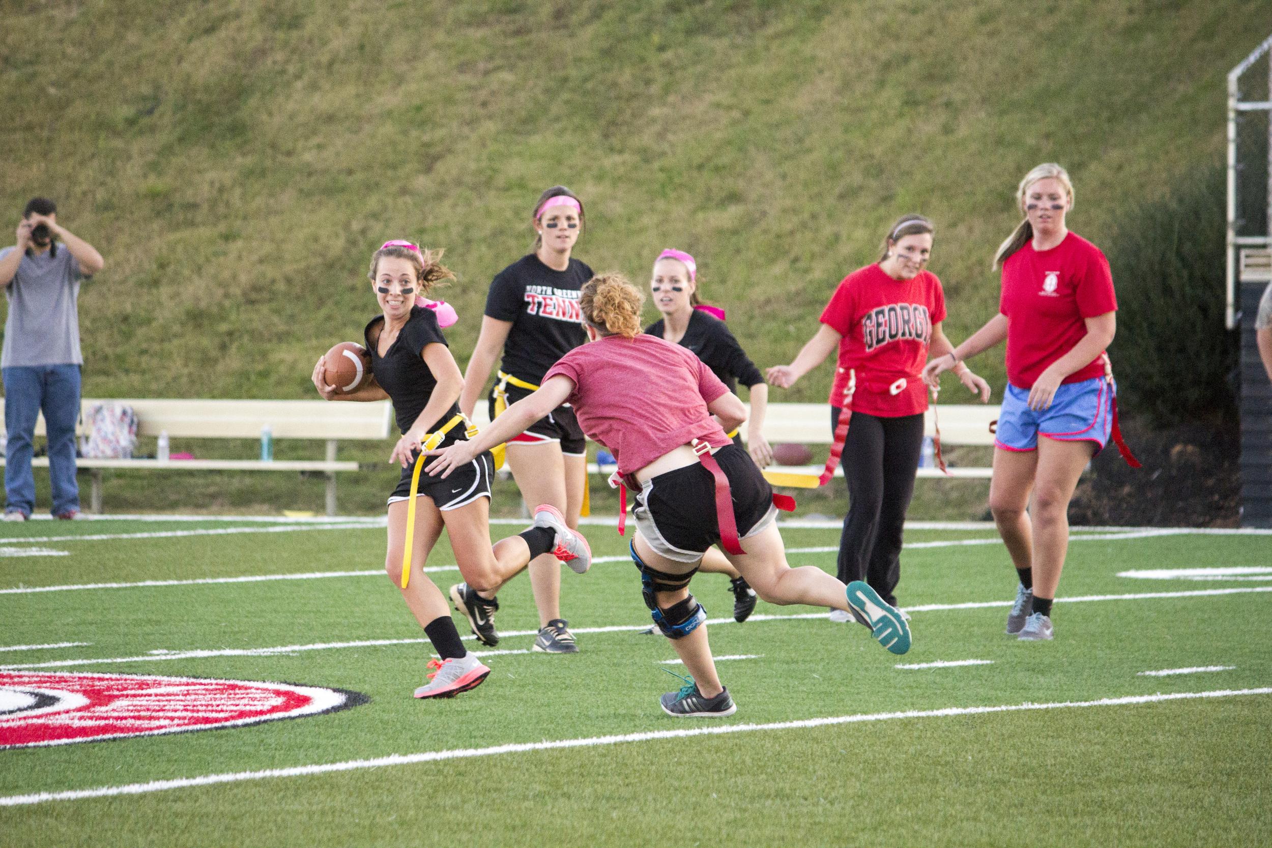 Senior Heather Dabbs anticipates Kacey Beck's running play.